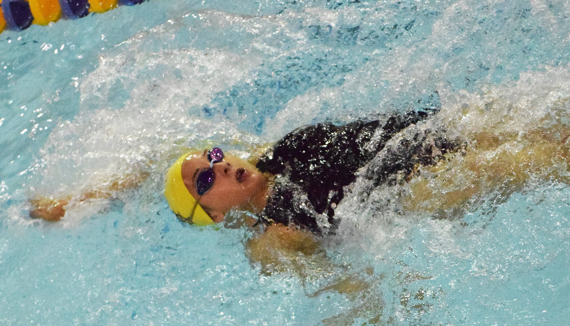 Homer's Madison Story races in the girls 200-yard IM final Saturday, Oct. 27, 2018 at the Northern Lights Conference championship swim meet at Homer High School in Homer, Alaska. (Photo by Joey Klecka/Peninsula Clarion)