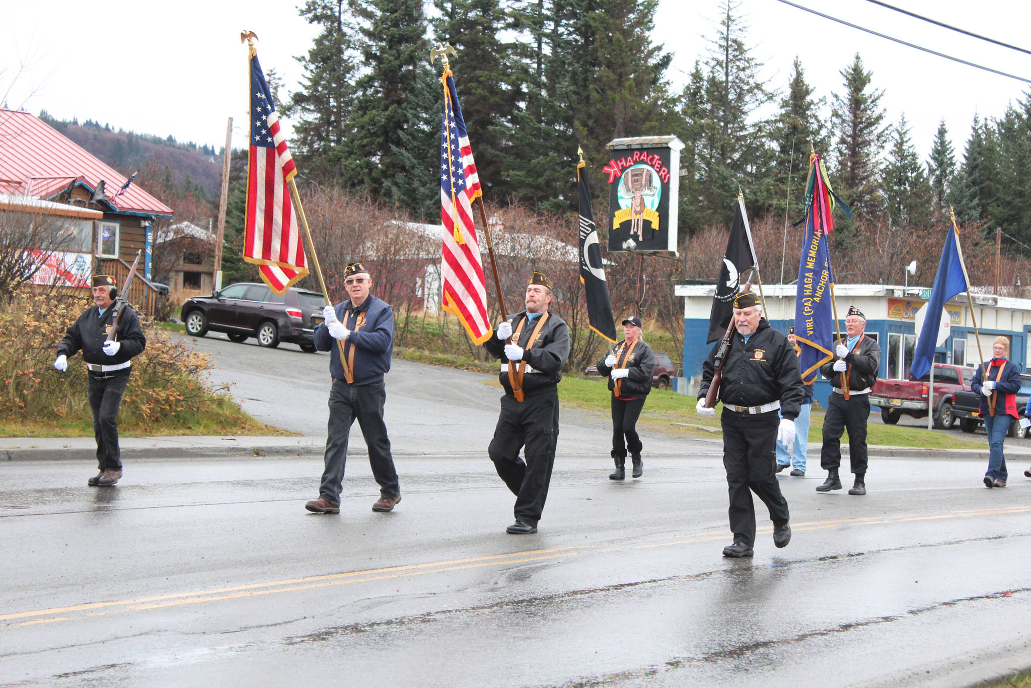 Members of veterans organizations march down Pioneer Avenue during in a Veterans Day parade Sunday, Nov. 11, 2018 in Homer, Alaska. (Photo by Megan Pacer/Homer News)