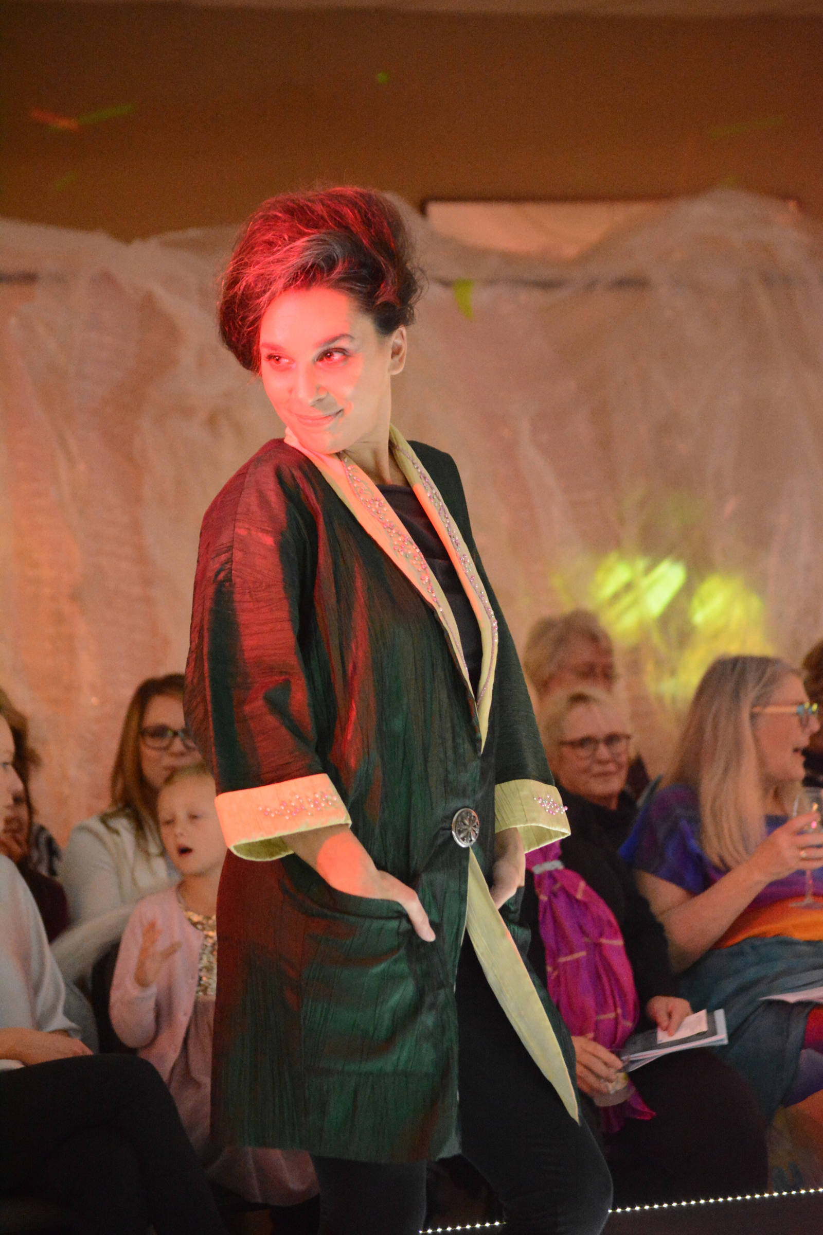 Rebeka Tufares wears a 1980s era jacket by Barb and C.A. Meyers at the 2018 Wearable Arts on Nov. 17, 2018, in Homer, Alaska. (Photo by Michael Armstrong/Homer News)