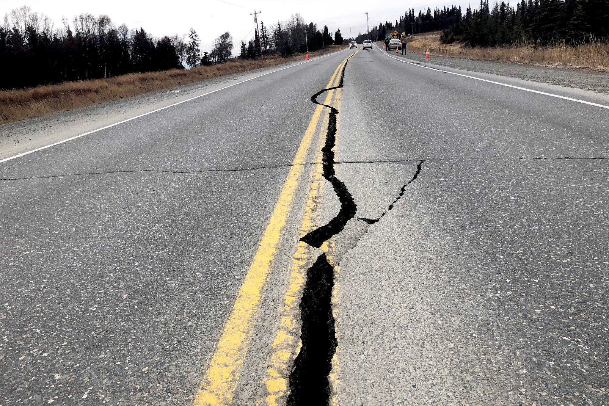 The road at Mile 19 of the Kenai Spur Highway near Nikiski cracked down the middle after the Friday, Nov. 30, 2018 earthquake near Anchorage, Alaska. (Photo by Victoria Petersen/Peninsula Clarion)