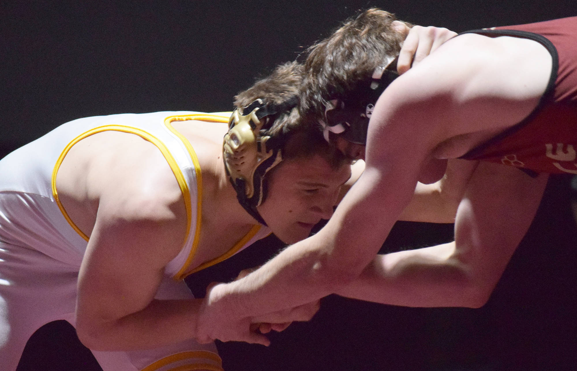 Voznesenka's Anthony Kalugin locks horns with Eliot Merriner of Grace on Saturday, Dec. 8, 2018 in the 171-pound championship at the Kachemak Conference wrestling tournament at Grace Christian High School in Anchorage, Alaska. (Photo by Joey Klecka/Peninsula Clarion)