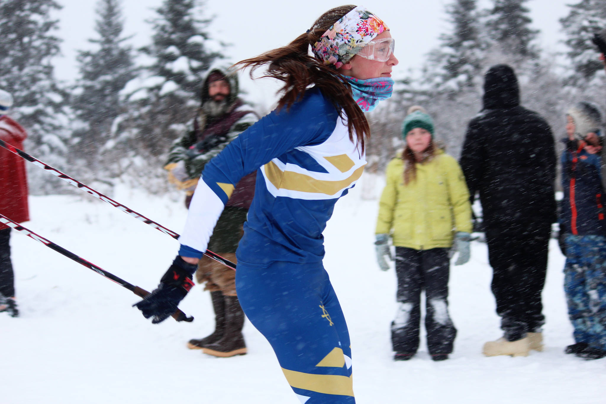 Homer junior Autumn Daigle breezes across the finish line to take first place in the girls' race at a Homer-hosted ski meet Friday, Dec. 14, 2018 at the Ohlson Mountain Trails near Homer, Alaska. The meet was moved to Homer after it was decided the Tsalteshi Trails system in Soldotna didn't have enough snow. (Photo by Megan Pacer/Homer News)
