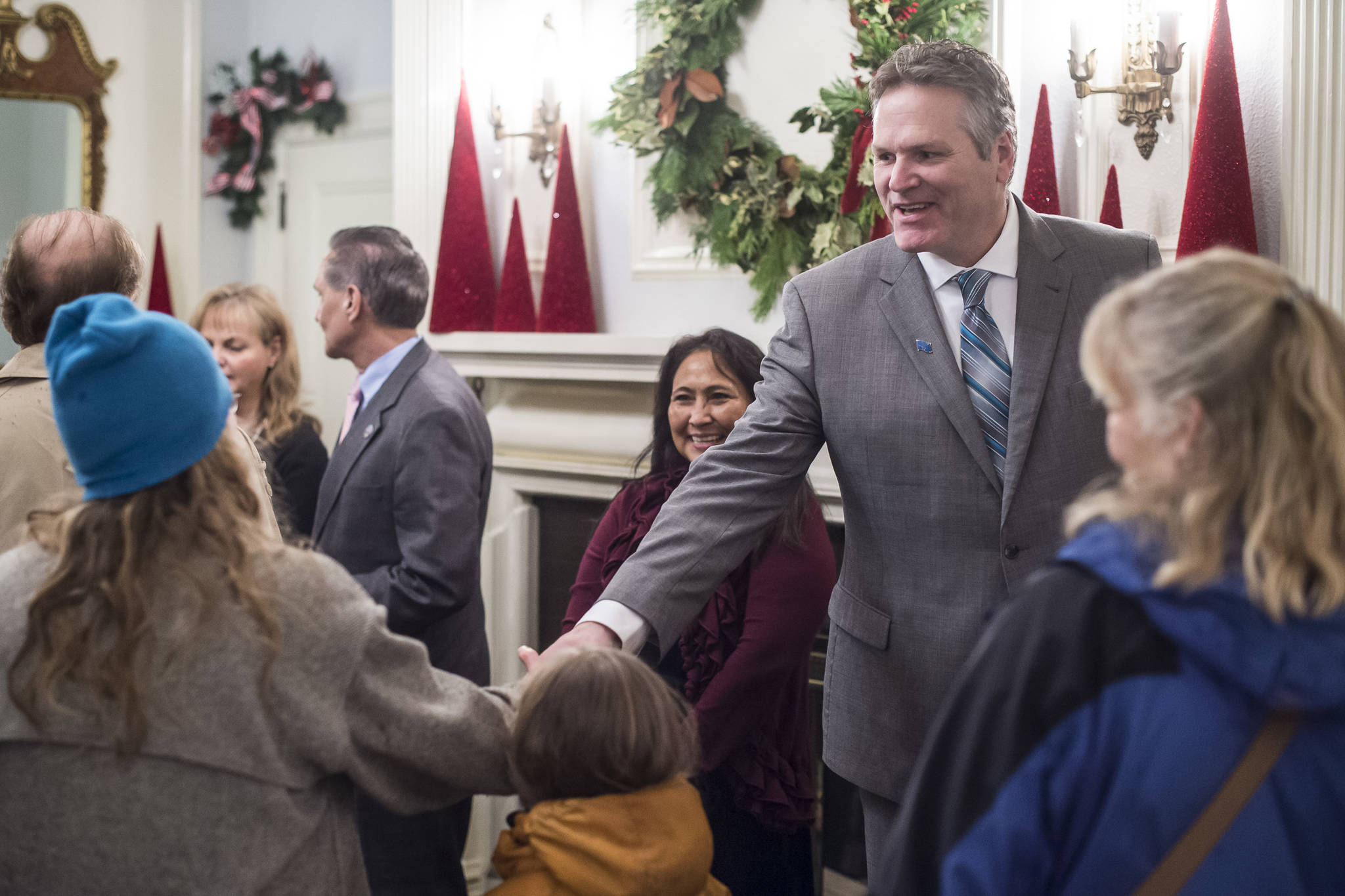 Gov. Mike Dunleavy and his wife, Rose, welcome Juneau residents at the Governor's Open House on Tuesday. (Michael Penn | Juneau Empire)