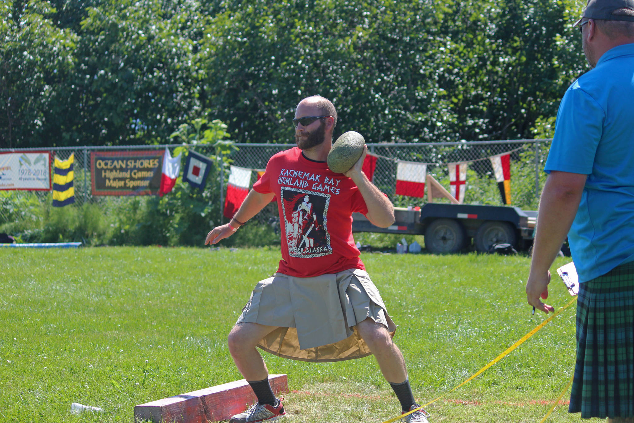 A novice competitor prepares to throw a braemar stone during the Kachemak Bay Scottish Highland Games on Saturday, July 7, 2018 at Karen Hornaday Park in Homer, Alaska. (Homer News file photo)