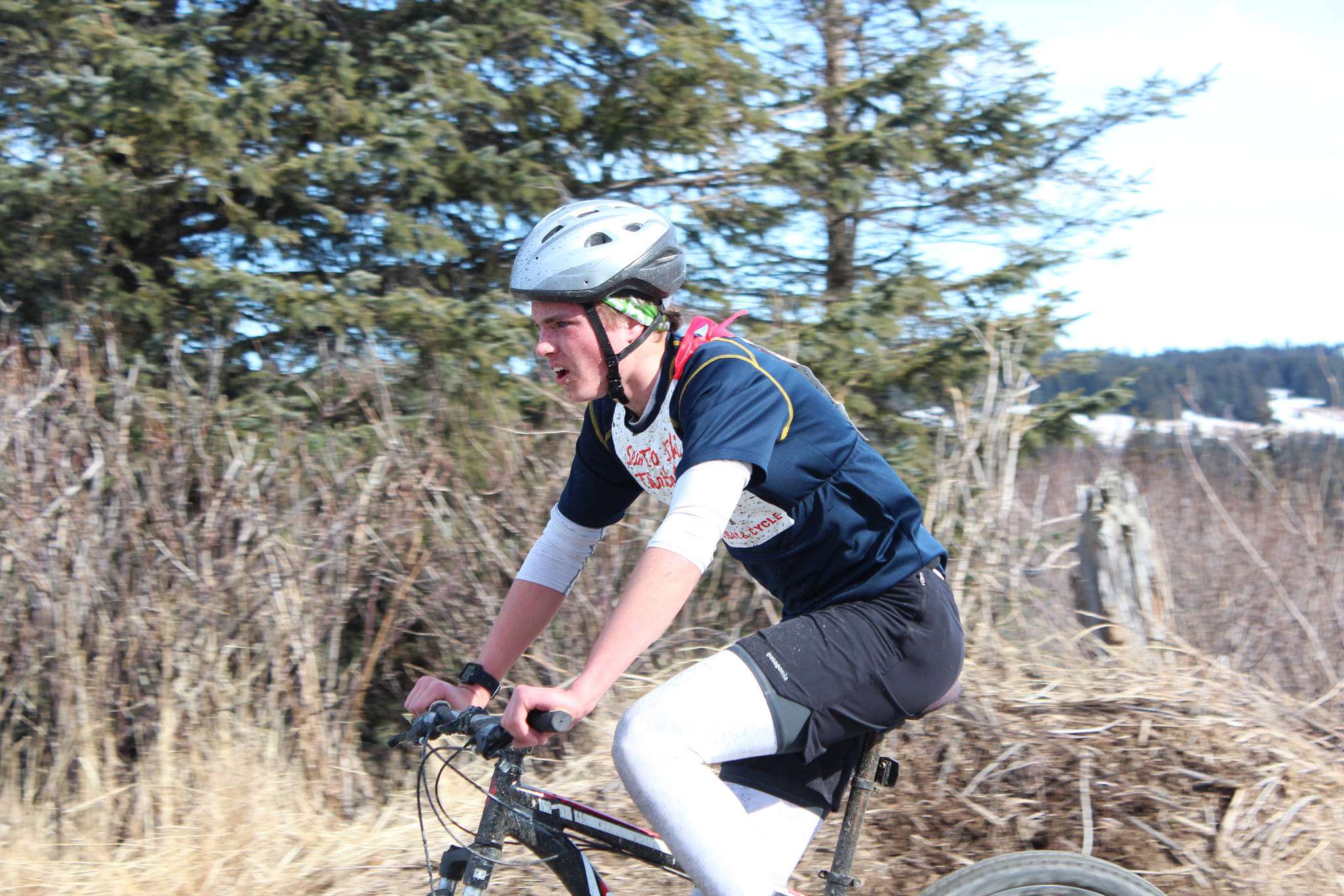 Homer High School senior Denver Waclawski bikes into the second transition station of this year's Sea to Ski Triathlon. He finished first in all three legs of the race and took first place overall Sunday, March 25, 2017 in Homer, Alaska. (Homer News file photo)