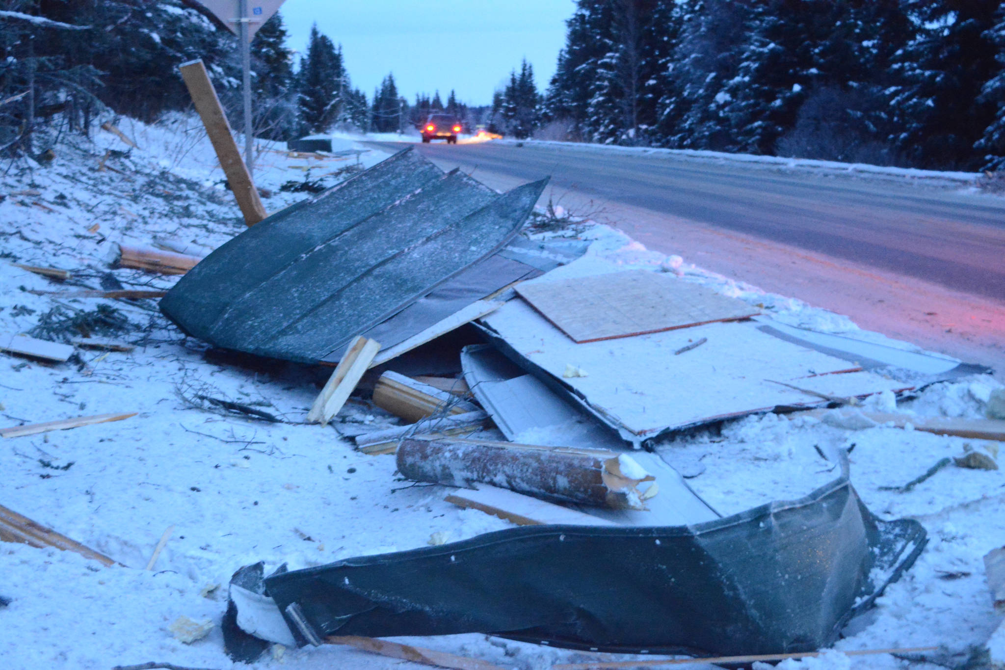 Debris from an exploded house is piled by the road near Mile 166 Sterling Highway on Friday, Dec. 28, 2018, near Homer, Alaska. The debris field from the explosion spread at least 200 feet in all directions. (Photo by Michael Armstrong/Homer News).