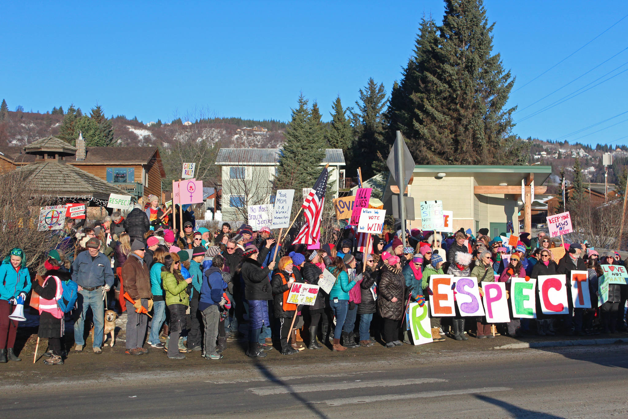 Participants in the 2019 Women's March on Homer gather at WKFL Park following the march Saturday, Jan. 19, 2019 in Homer, Alaska. (Photo by Megan Pacer/Homer News)