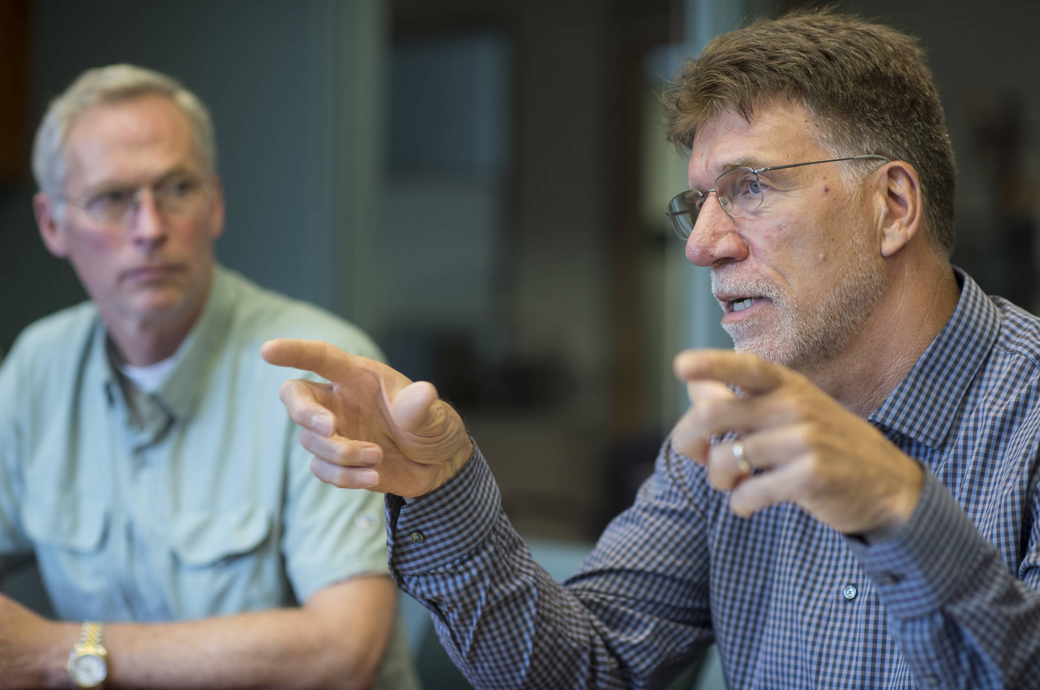 University of Alaska President Jim Johnsen, left, listens to Dr. Steve Atwater, Executive Dean of the university's new Alaska College of Education, during an interview at the University of Alaska Southeast on Friday, August 3, 2018. (Michael Penn | Juneau Empire)