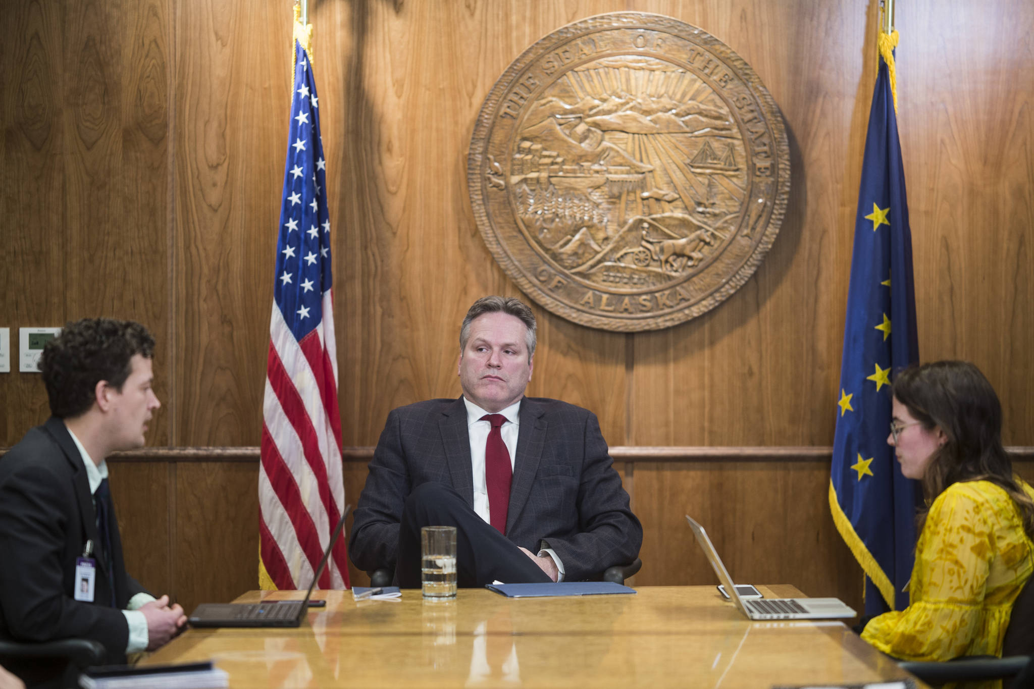 Juneau Empire reporters Kevin Baird, left, and Mollie Barnes interview Gov. Mike Dunleavy at the Capitol on Tuesday, Feb. 26, 2019. (Michael Penn | Juneau Empire)