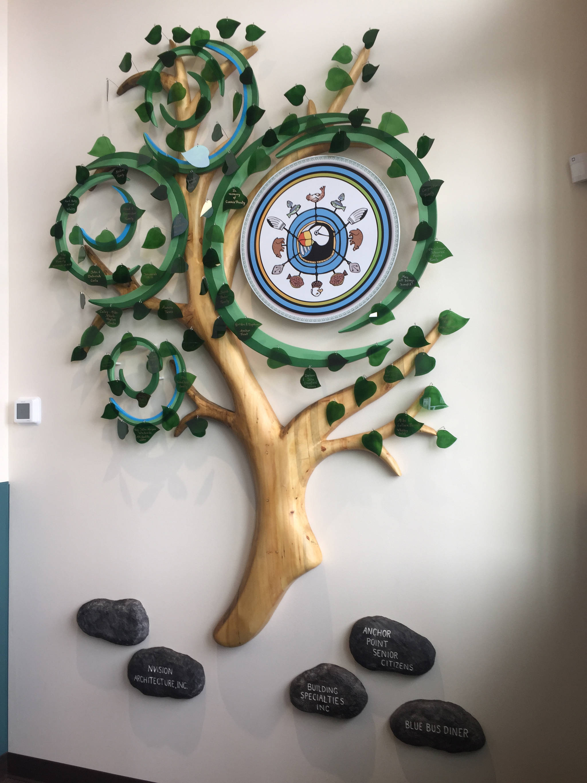 The Anchor Point Family Tree, crafted by Ben Firth of Ben Firth Studio, is the first thing visitors to the new health center see as they walk through the front door. (Photo by Delcenia Cosman)