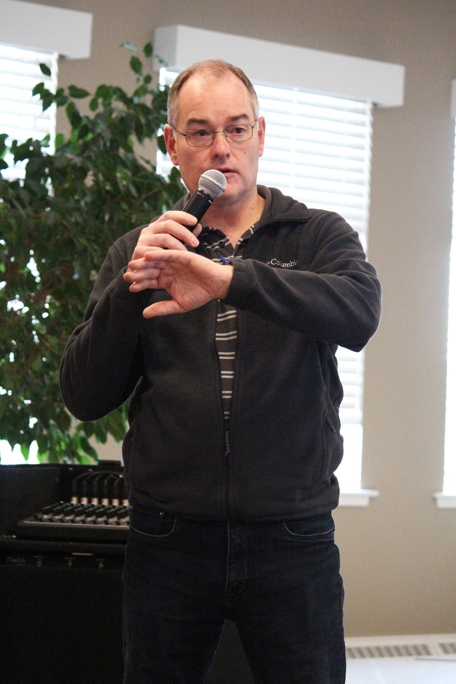 James Fueg, vice president of permitting for the Pebble Limited Partnership, speaks to a crowd of people at a community meeting Tuesday, March 19, 2019 at Land's End Resort in Homer, Alaska. (Photo by Megan Pacer/Homer News)