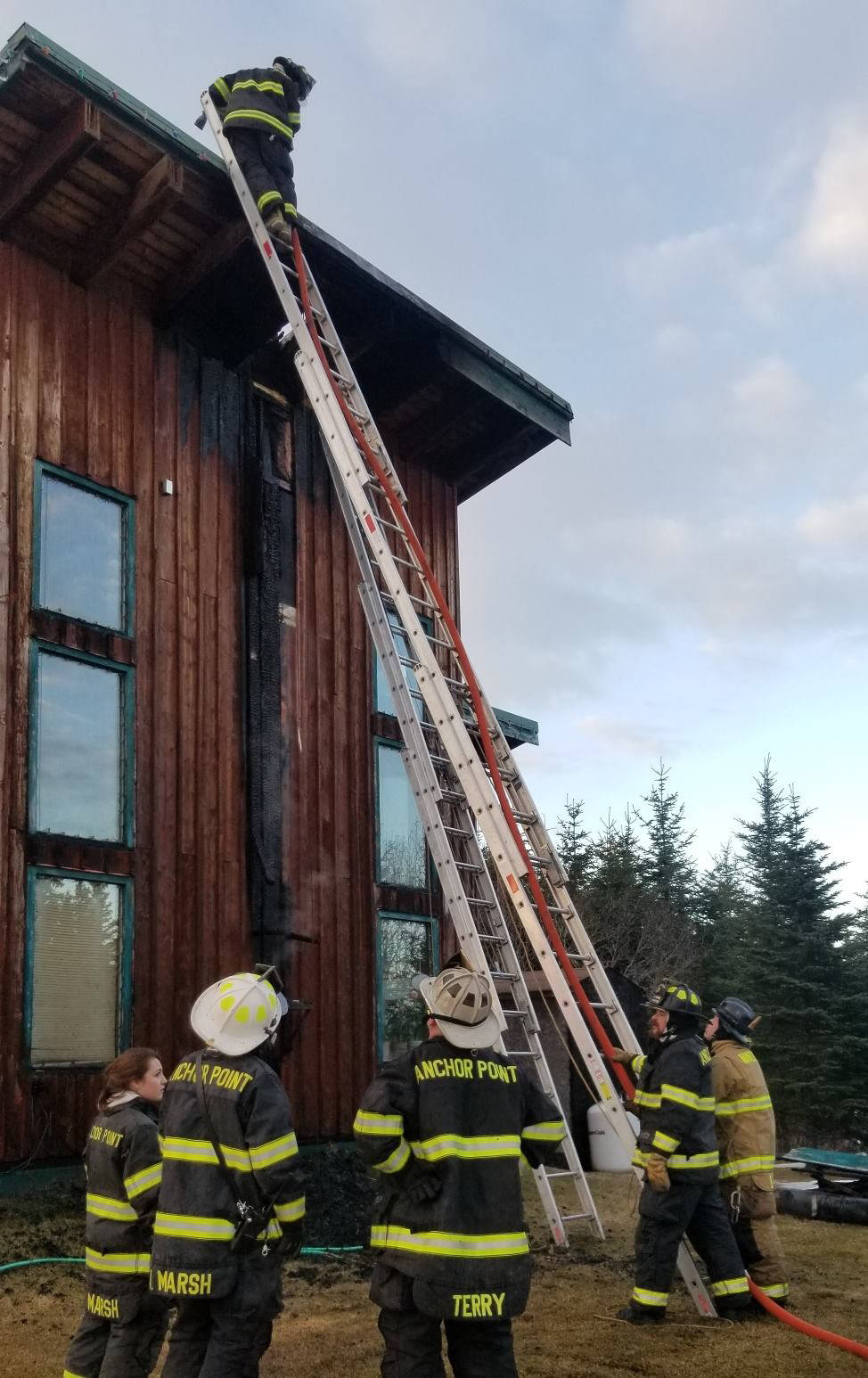 Anchor Point Fire & EMS and Ninilchik Emergency Services firefighters respond to a chimney fire at a Long Gone Avenue home after 7:15 p.m. April 5, 2019, near Anchor Point, Alaska. (Photo provided)