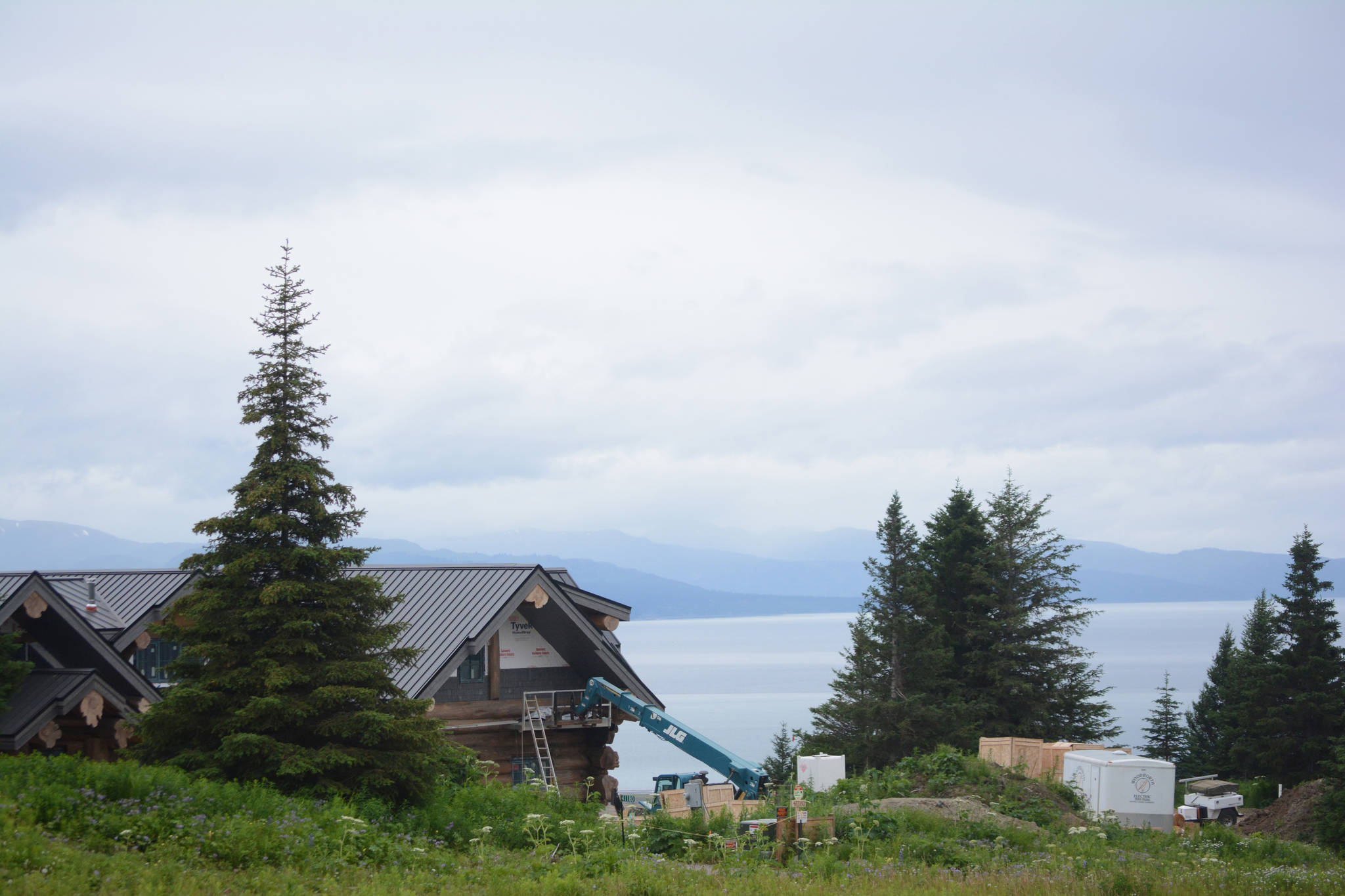 Part of country-western singer Zac Brown's log home is visible from Dorothy Drive overlooking Kachemak Bay in Homer, Alaska in this photo taken on July 9, 2018. A pedestrian easement to the right in this photo runs between Brown's property and his neighbor. Brown and other neighbors at the end of the rural road have petitioned to vacate a north-south section line easement that crosses Dorothy Drive and also runs south to a neighboring subdivision. (Photo by Michael Armstrong/Homer News)
