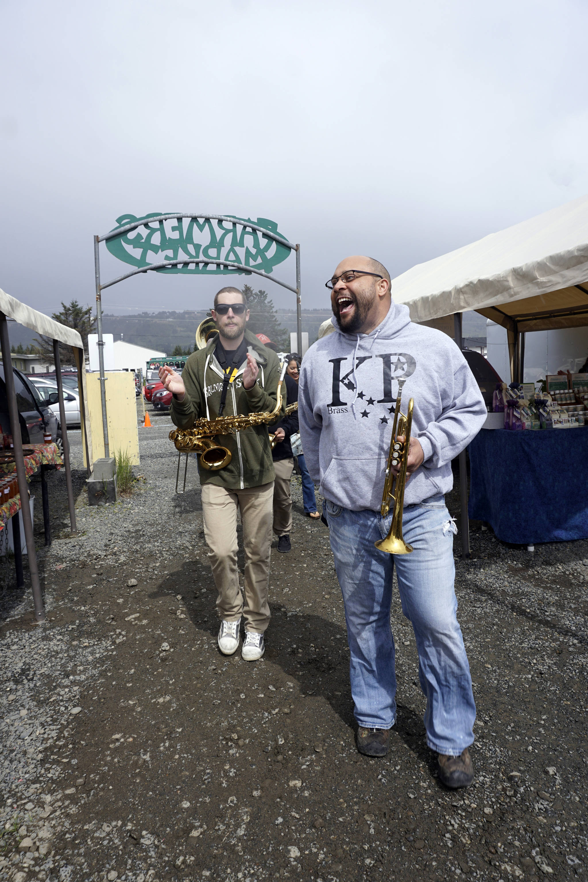 Nelton Palma marches with the KP Brass Band at the Homer Farmers Market for opening day on May 26, 2018. (Photo by Michael Armstrong/Homer News)