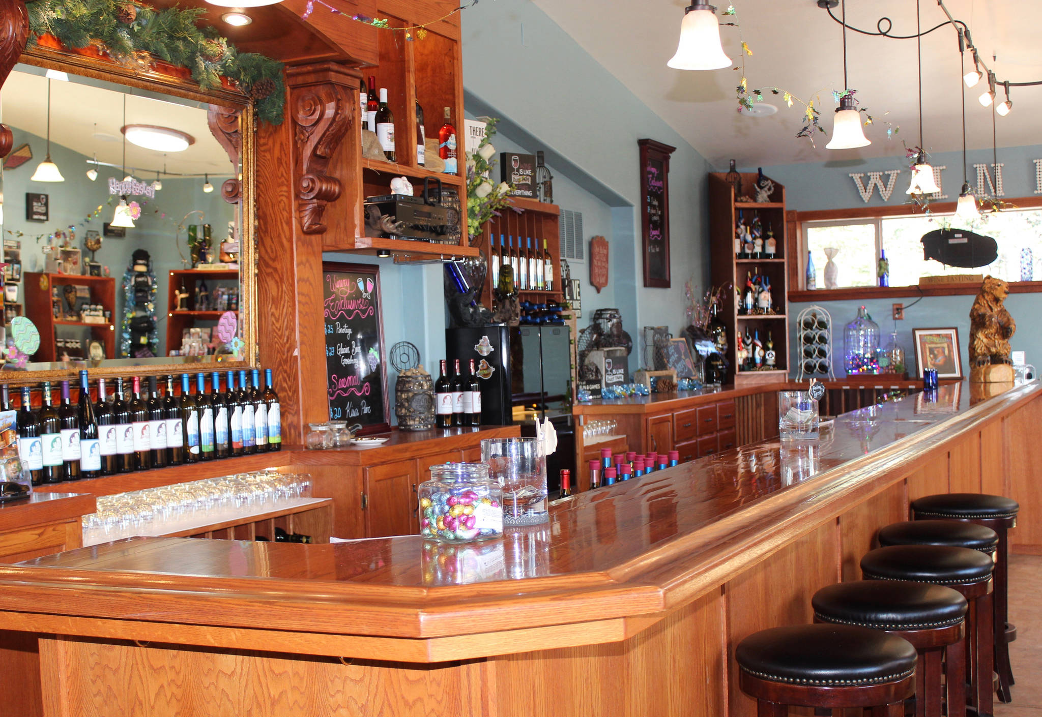 Bear Creek Winery's tasting room offers both of the winery's brands, as seen here in this photo taken April 17, 2019. The original Bear Creek brand has nine wines on the tasting list year-round and five seasonal wines. Five different wines are under the Glacier Bear brand, made strictly from Alaskan-grown berries and fruits at its location in Kachemak City, Alaska. (Photo by McKibben Jackinsky)