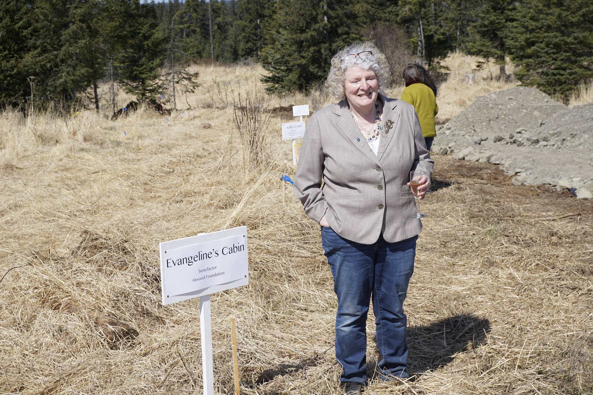 Homer writer and Storyknife Writers Retreat founder Dana Stabenow stands near the site of a cabin at groundbreaking ceremonies last Saturday, May 4, 2019, at the retreat property in Homer, Alaska. Construction started this month on the main house and cabins that will in a year house visiting women writers. (Photo by Michael Armstrong/Homer News)
