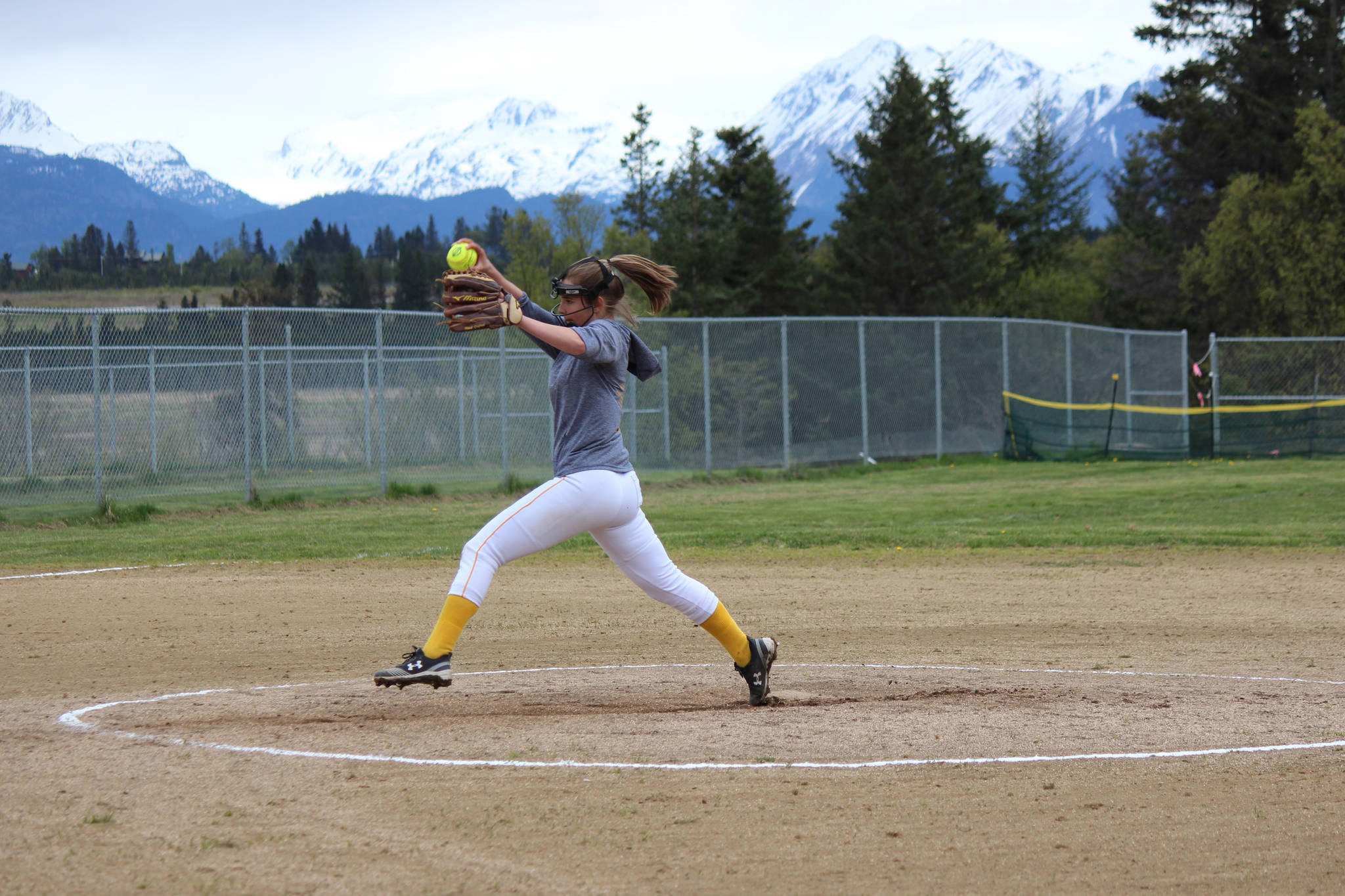 "Annalynn ""T-Rex"" Brown winds up to send a strike across home plate during the Mariners' game against Kenai on Saturday. (Photo by McKibben Jackinsky)"