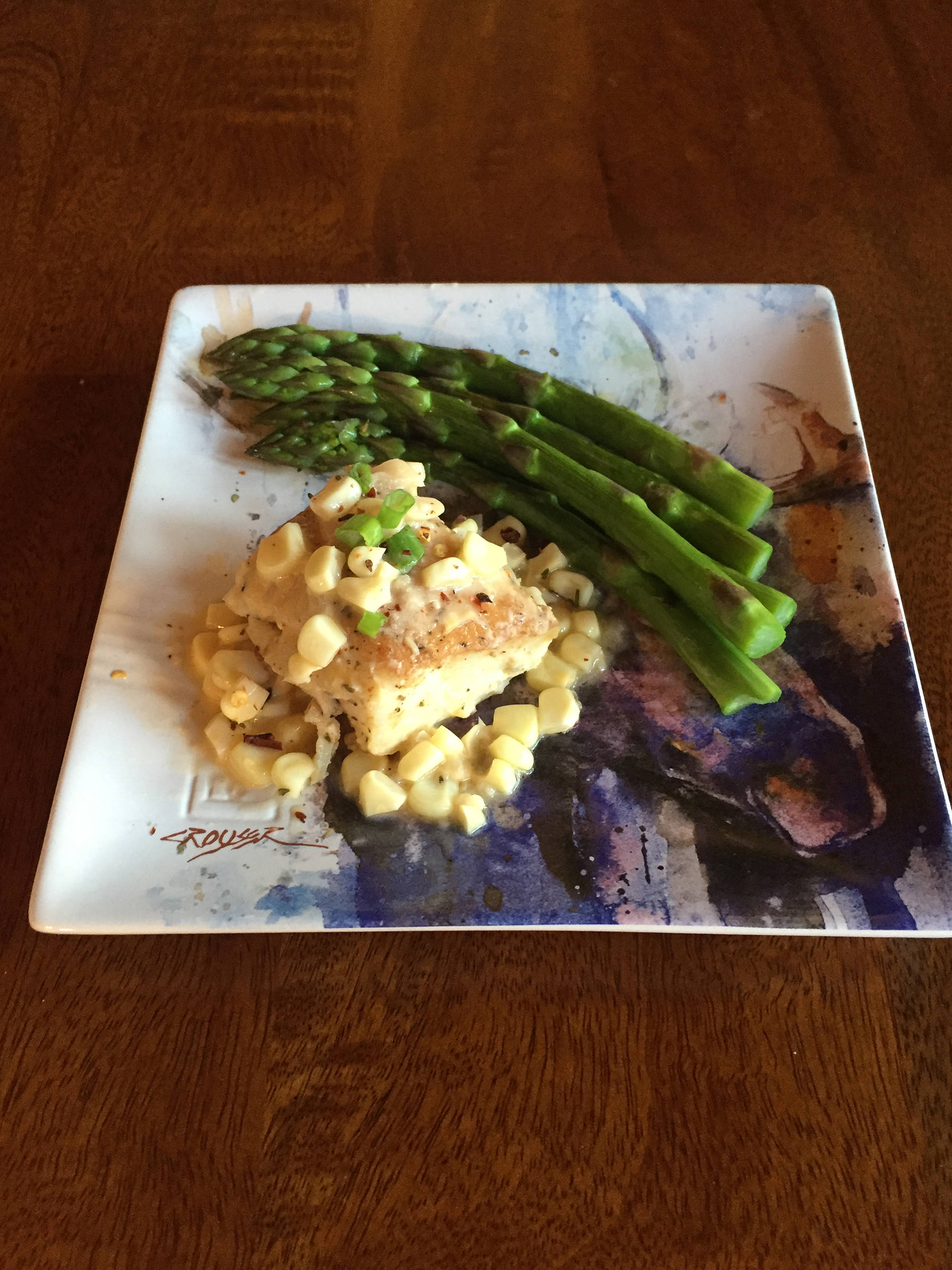 Corn in this recipe of roasted halibut with corn chardonnay butter sauce complements the taste of halibut, as prepared here on June 25, 2019, in Teri Robl's kitchen in Homer, Alaska. (Photo by Teri Robl)