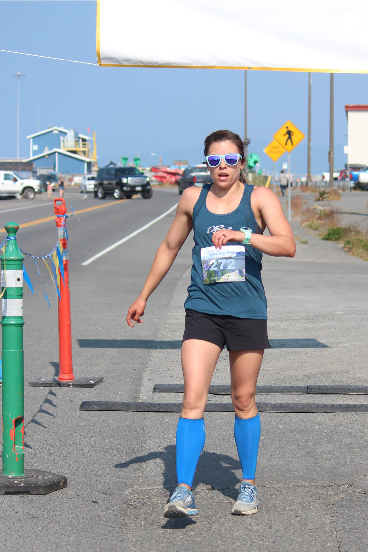Kristyn Turney of Anchorage takes first place for the women in the Spit Run 10k to the Bay on Saturday, June 29, 2019 in Homer, Alaska. (Photo by Megan Pacer/Homer News)