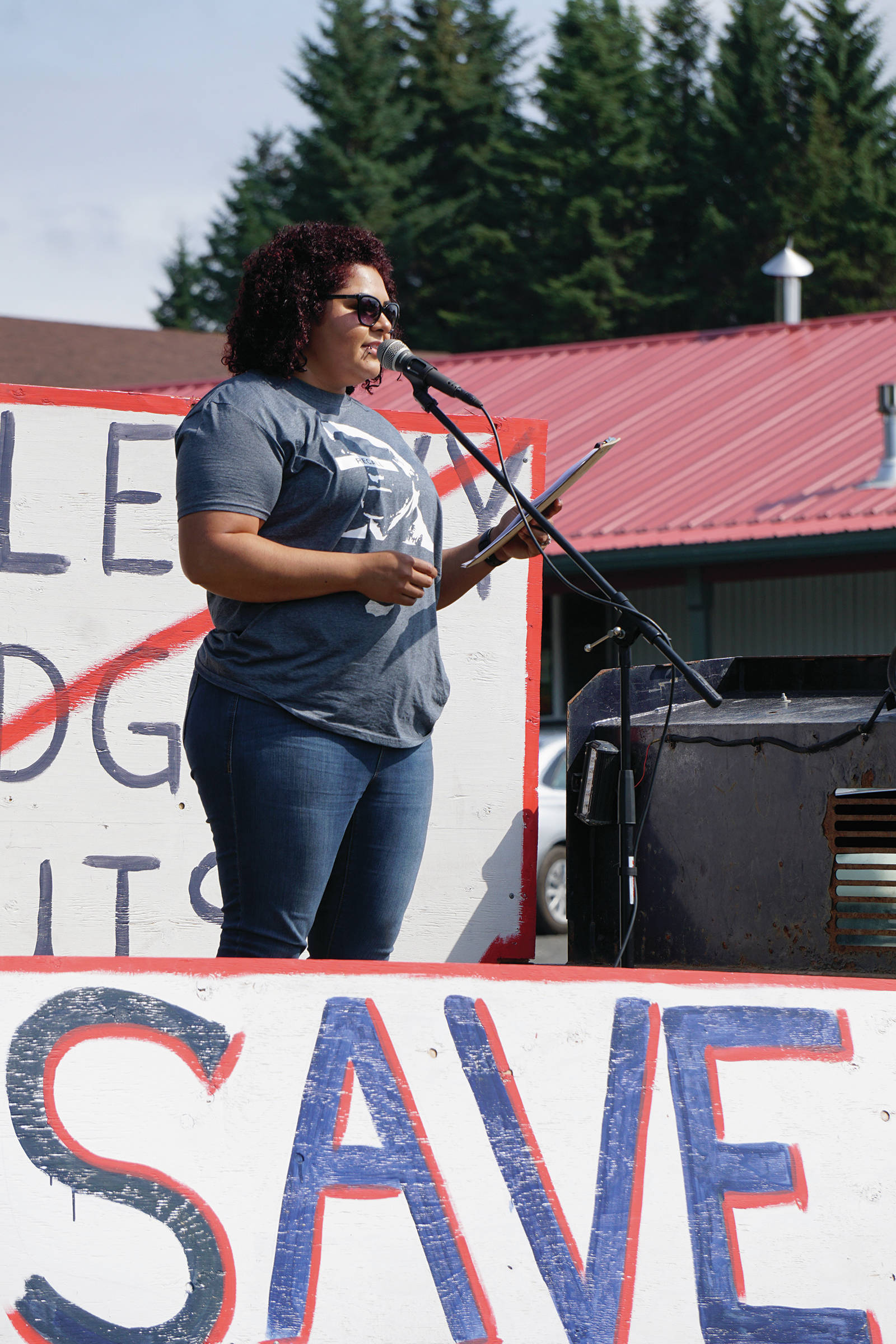 Xochitl Lopez-Ayala speaks at a rally Sunday, July 28, 2019, against Gov. Mike Dunleavy's budget cuts at the Legislative Information Office, Homer, Alaska. (Photo by Michael Armstrong/Homer News).