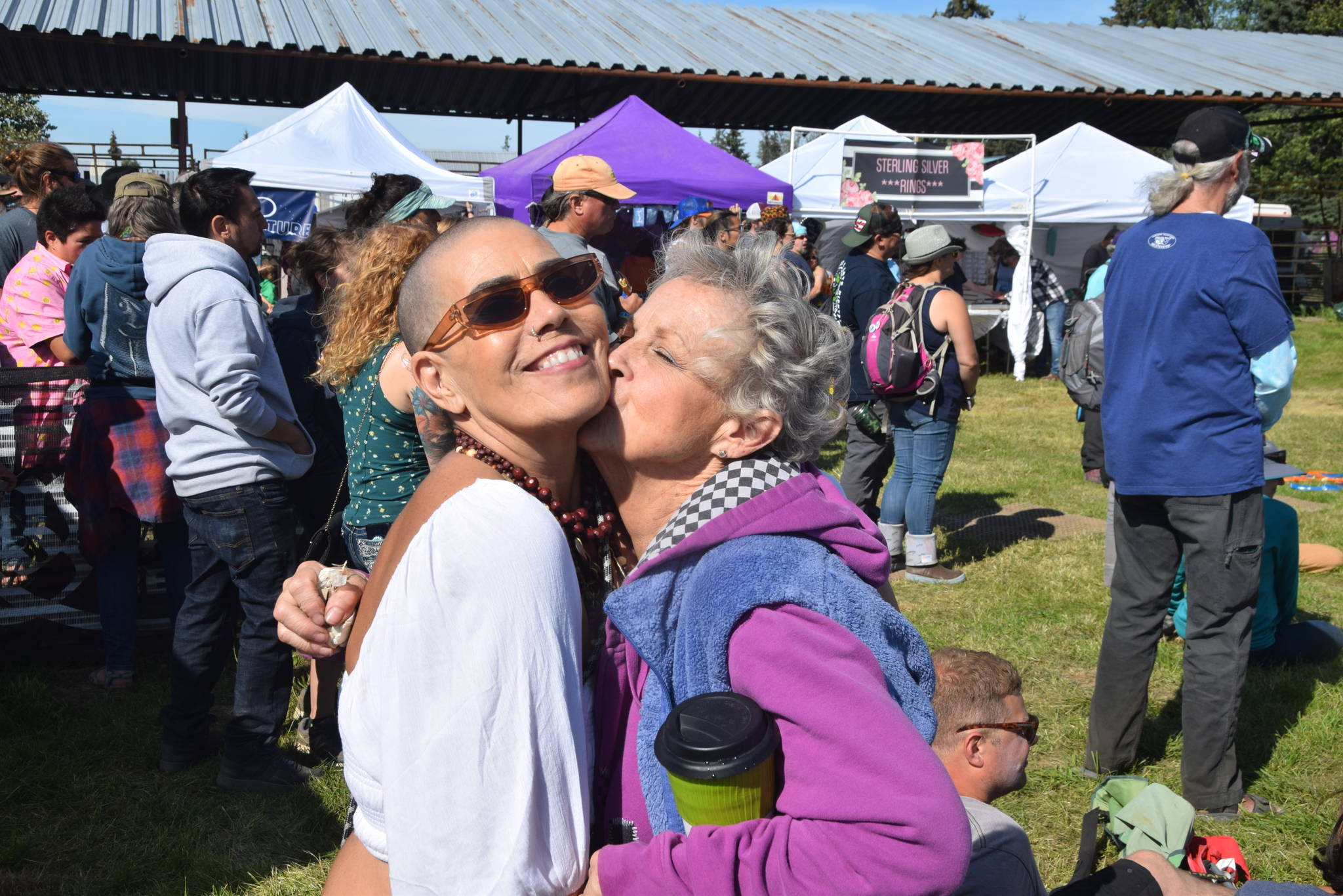 Monet Barbee, left and Judy Casey, right, pose for the camera during Salmonfest 2019 in Ninilchik, Alaska on August 2, 2019. (Photo by Brian Mazurek/Peninsula Clarion)