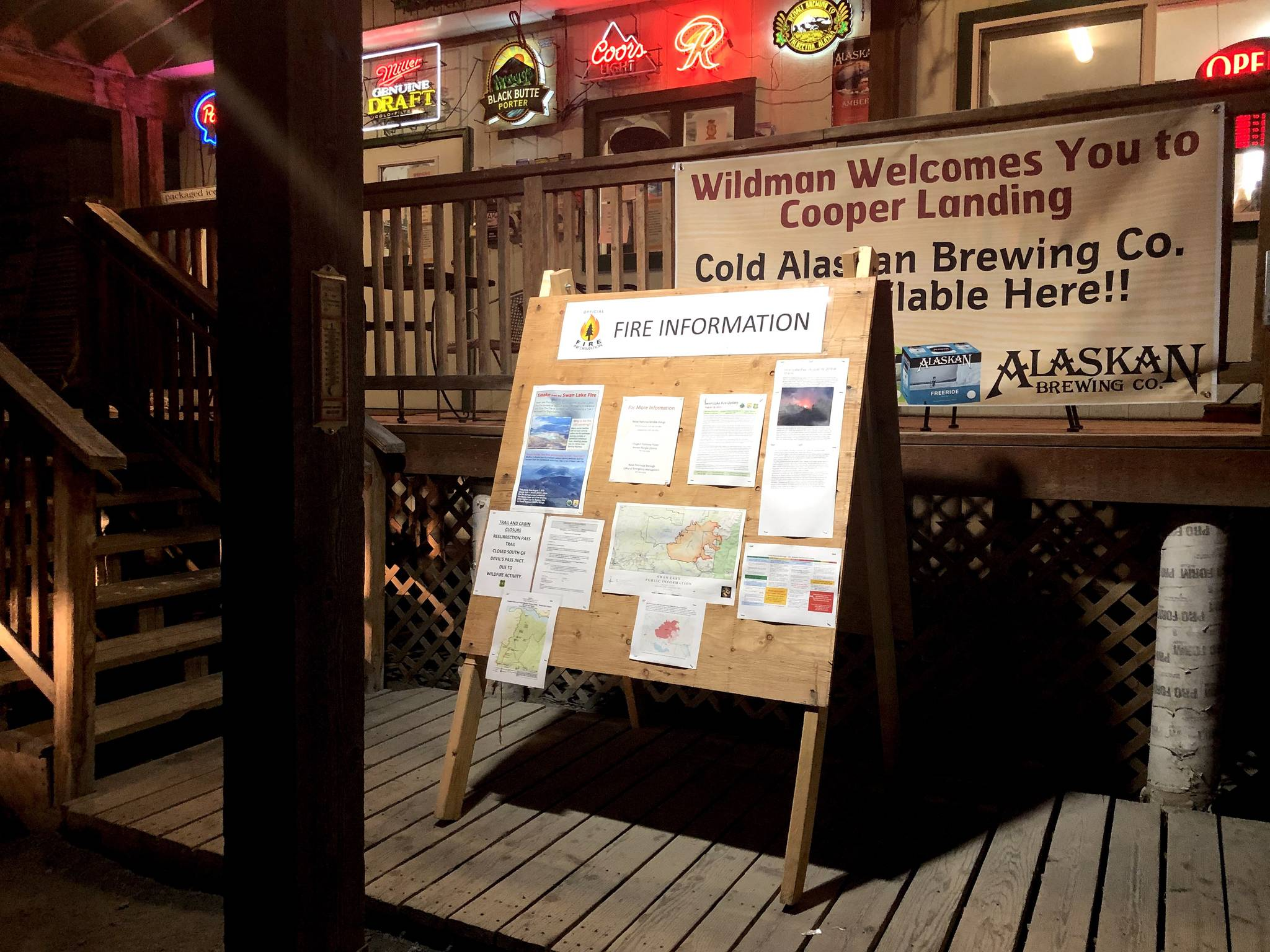 Fire information is posted outside of Wildmans in Cooper Landing on Aug. 19, 2019. (Photo by Victoria Petersen/Peninsula Clarion)