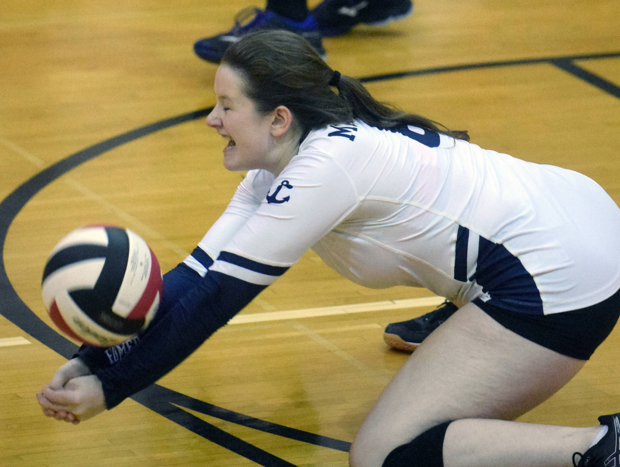 Homer's Kitri Classen digs up a ball against Kenai Central on Tuesday, Sept. 10, 2019, at Kenai Central High School in Kenai, Alaska. (Photo by Jeff Helminiak/Peninsula Clarion)