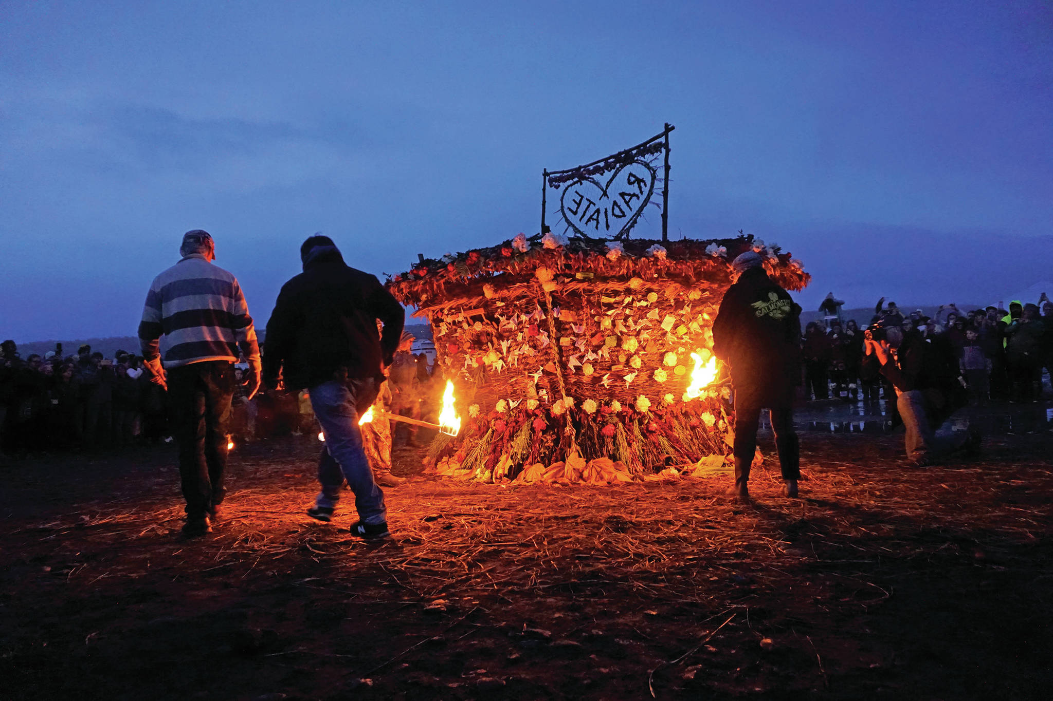 "Torch bearers prepare to ignite""Radiate,"" the 16th annual Burning Basket, on Sunday night, Sept. 15, 2019, at Mariner Park on the Homer Spit in Homer, Alaska. (Photo by Michael Armstrong/Homer News)"