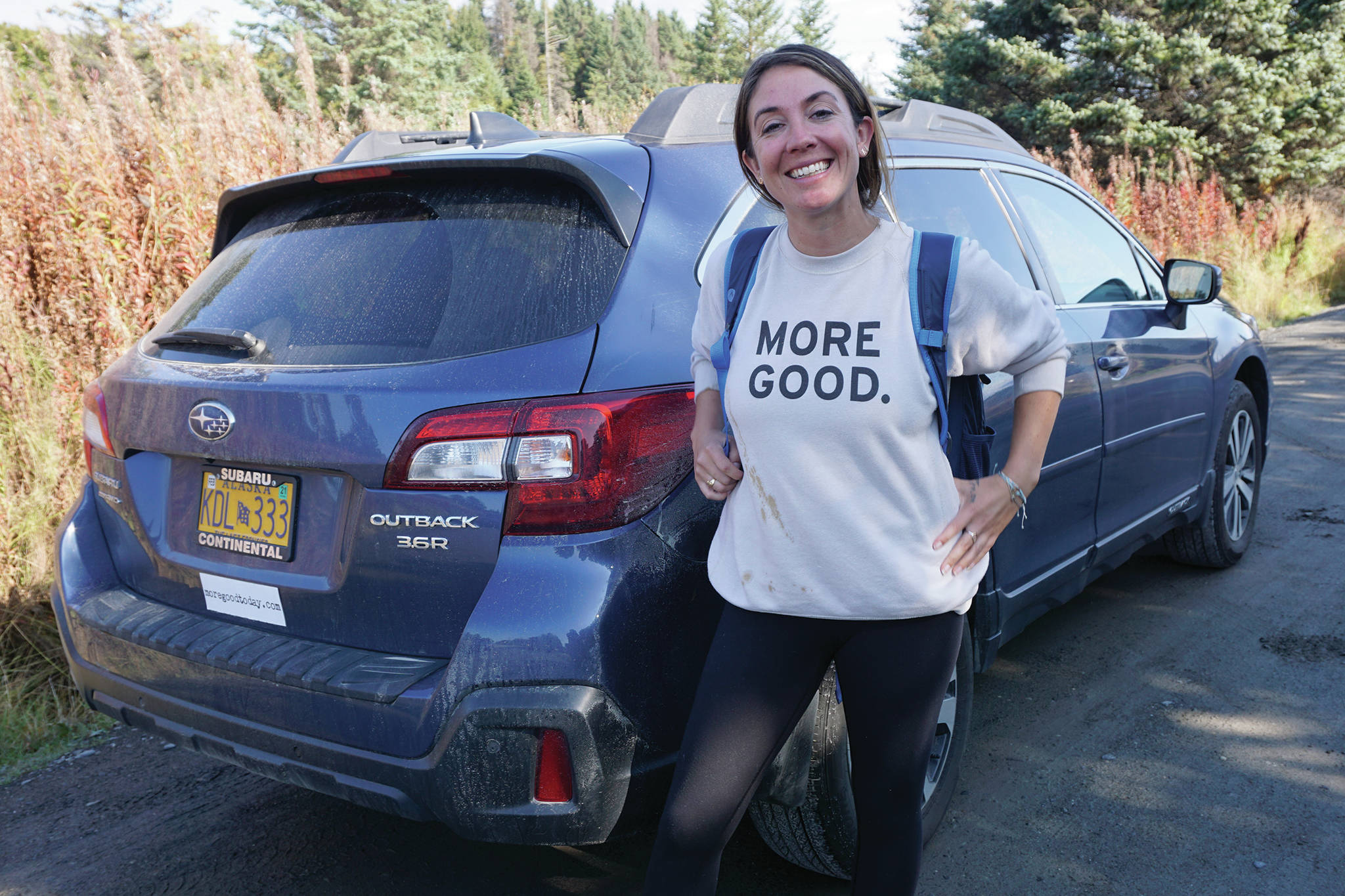 Mary Latham stands by her borrowed blue Subaru Outback on Sept. 16, 2019, in Homer, Alaska. Latham has been touring the United States collecting stories of human kindness to put in a book for people to read in hospital waiting rooms. Alaska is the 48th state Latham has visited since starting her trip in September 2016. (Photo by Michael Armstrong/Homer News)