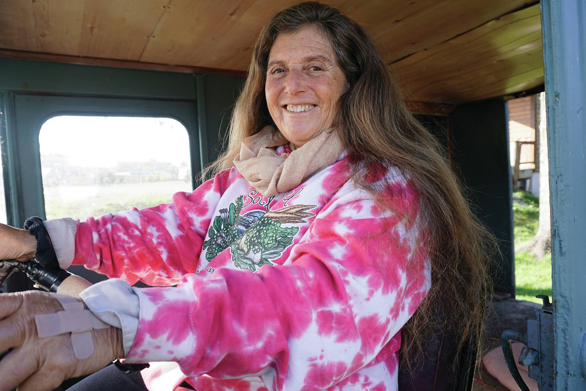 Donna Maltz poses in the original Fresh Sourdough Express Bakery and Cafe van on Sept. 27, 2019, as the landmark business held a going-out-of-business garage sale at its Ocean Drive location in Homer, Alaska. (Photo by Michael Armstrong/Homer News)
