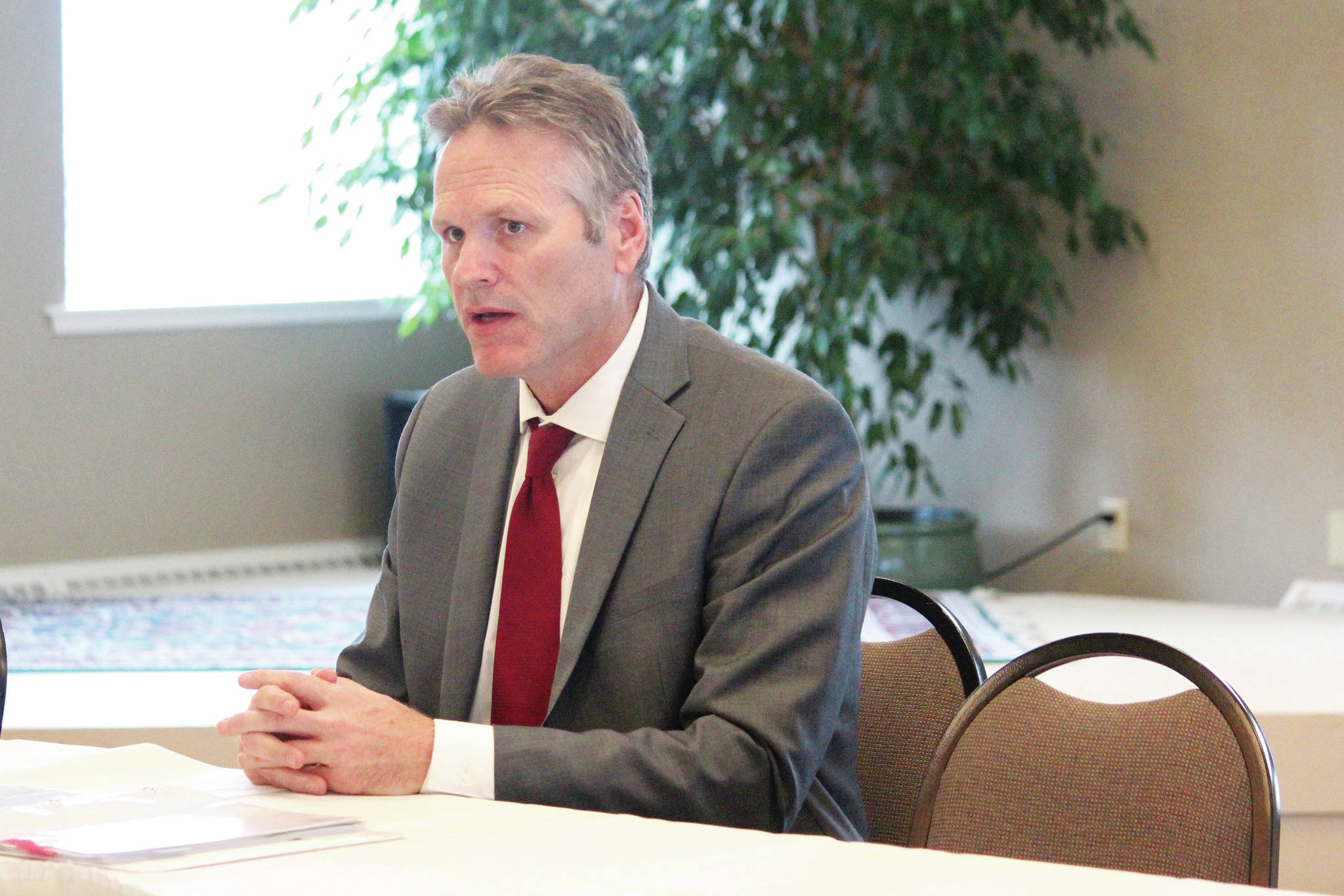 Gov. Mike Dunleavy speaks to attendees of a conference held by the Alaska State Home Building Association and the Kenai Peninsula Home Builders Association on Thursday, Oct. 17, 2019 at Land's End Resort in Homer, Alaska. Dunleavy came to brief conference participants on the statewide economy. (Photo by Megan Pacer/Homer News)
