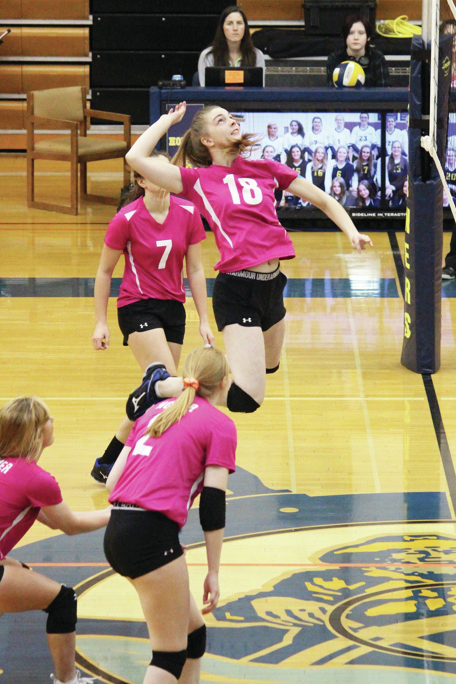 Homer's Karmyn Gallios jumps to spike the ball during a Friday, Oct. 18, 2019 volleyball game against Seward High School in the Alice Witte Gymnasium in Homer, Alaska. (Photo by Megan Pacer/Homer News)