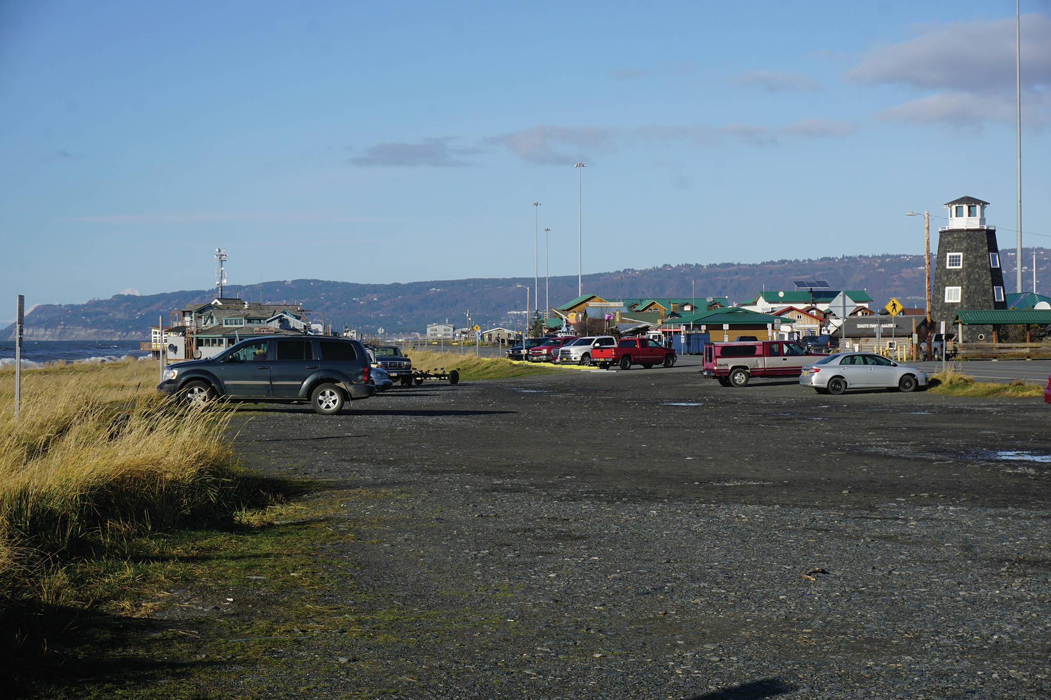 The Seafarers Memorial parking lot is mostly empty on Oct. 25, 2019, on the Homer Spit in Homer, Alaska. The city has applied for a conditional use permit to fill in and extend the parking lot to the left in this photo, or toward the beach. The angled parking spaces by the Homer Spit Road also would be removed except in front of the Cannery Row Boardwalk.(Photo by Michael Armstrong/Homer News)