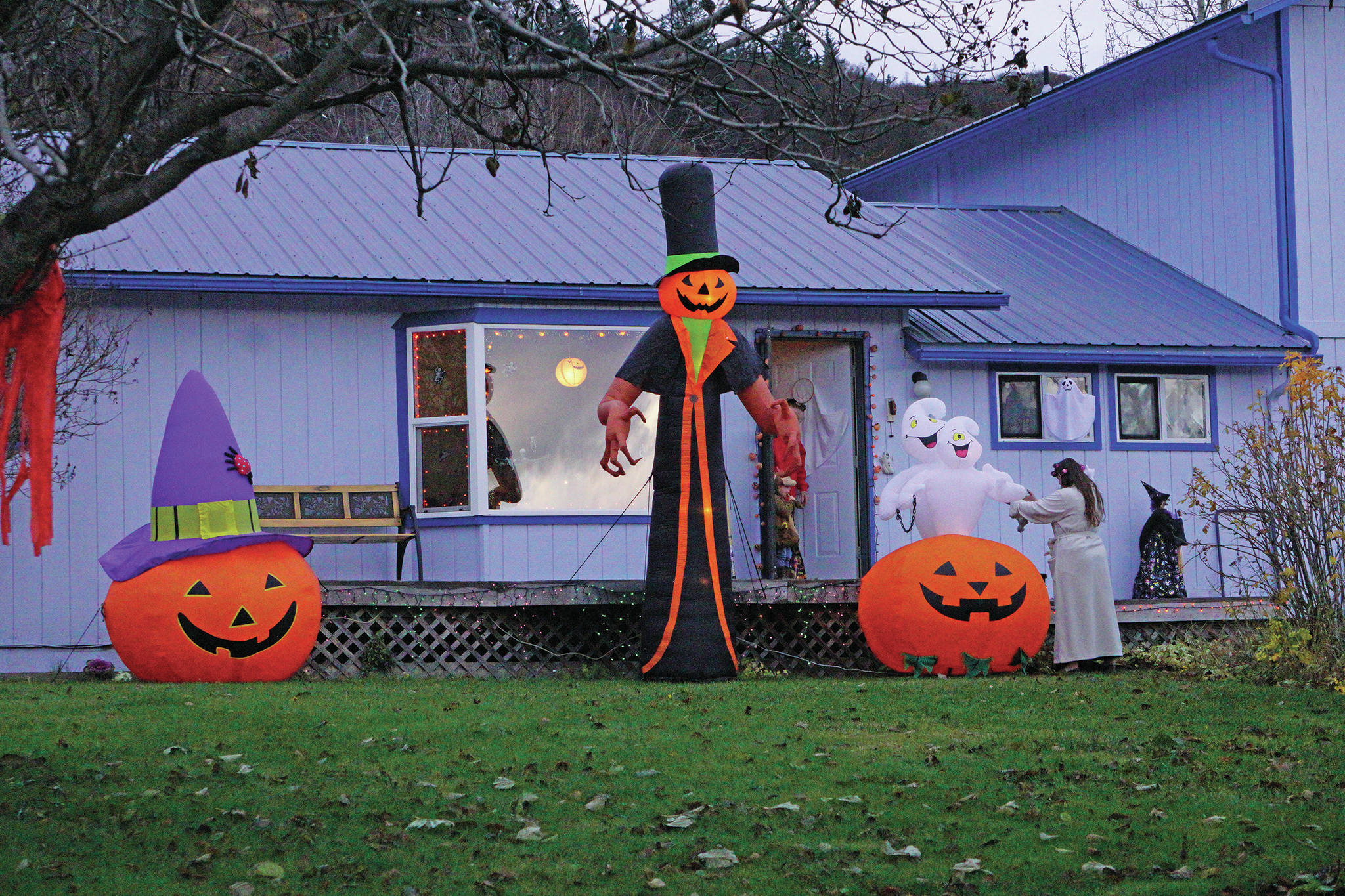 Halloween trick-or-treaters visit the Linda and David Etzwiler home, one of several homes decorated on Bayview Avenue, on Oct. 31, 2019, in Homer, Alaska. (Photo by Michael Armstrong/Homer News)