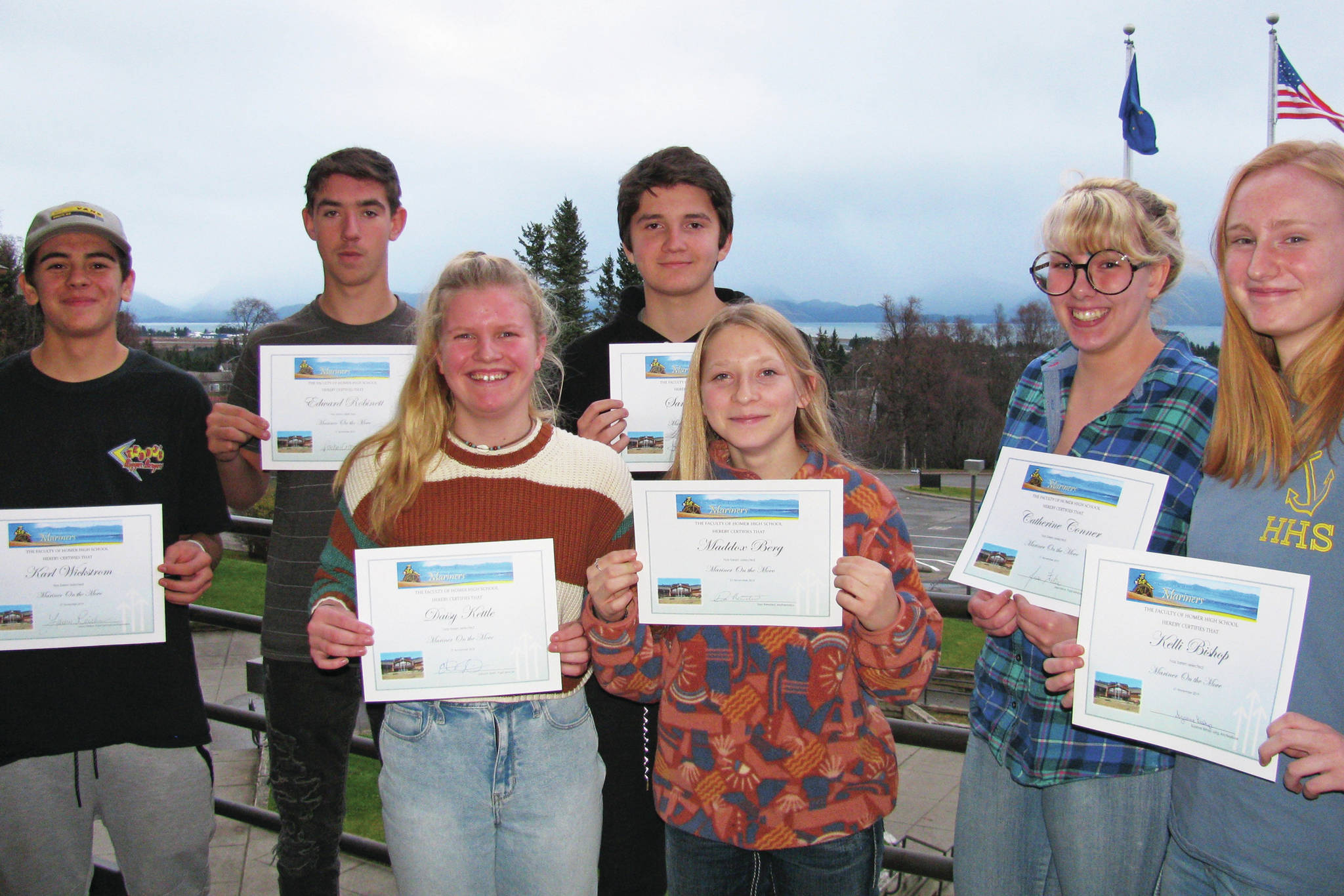 From left to right: Karl Wickstrom, Eddie Robinett, Daisy Kettle, Sam Cary, Maddox Berg, Catherine Conner and Kelli Bishop pose for a photo after being awarded this quarter's Mariners on the Move in this undated photo at Homer High School in Homer, Alaska. Not pictured: Skyler Rodriguez. (Photo courtesy Paul Story)