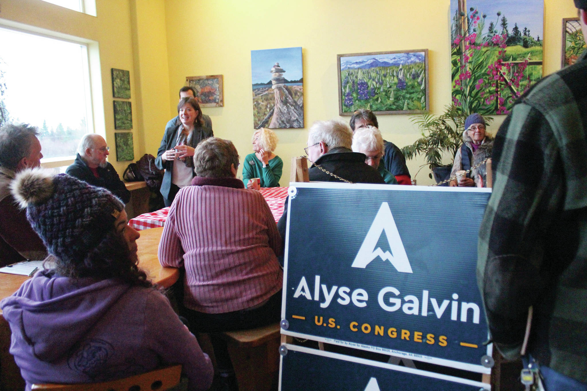 Community members listen to Alyse Galvin, who is running for the Alaska seat in the U.S. House of Representatives, speak during a meet and greet Sunday. Dec. 1, 2019 at K-Bay Caffee in Homer, Alaska. Galvin first ran to unseat Rep. Don Young in 2018. (Photo by Megan Pacer/Homer News)