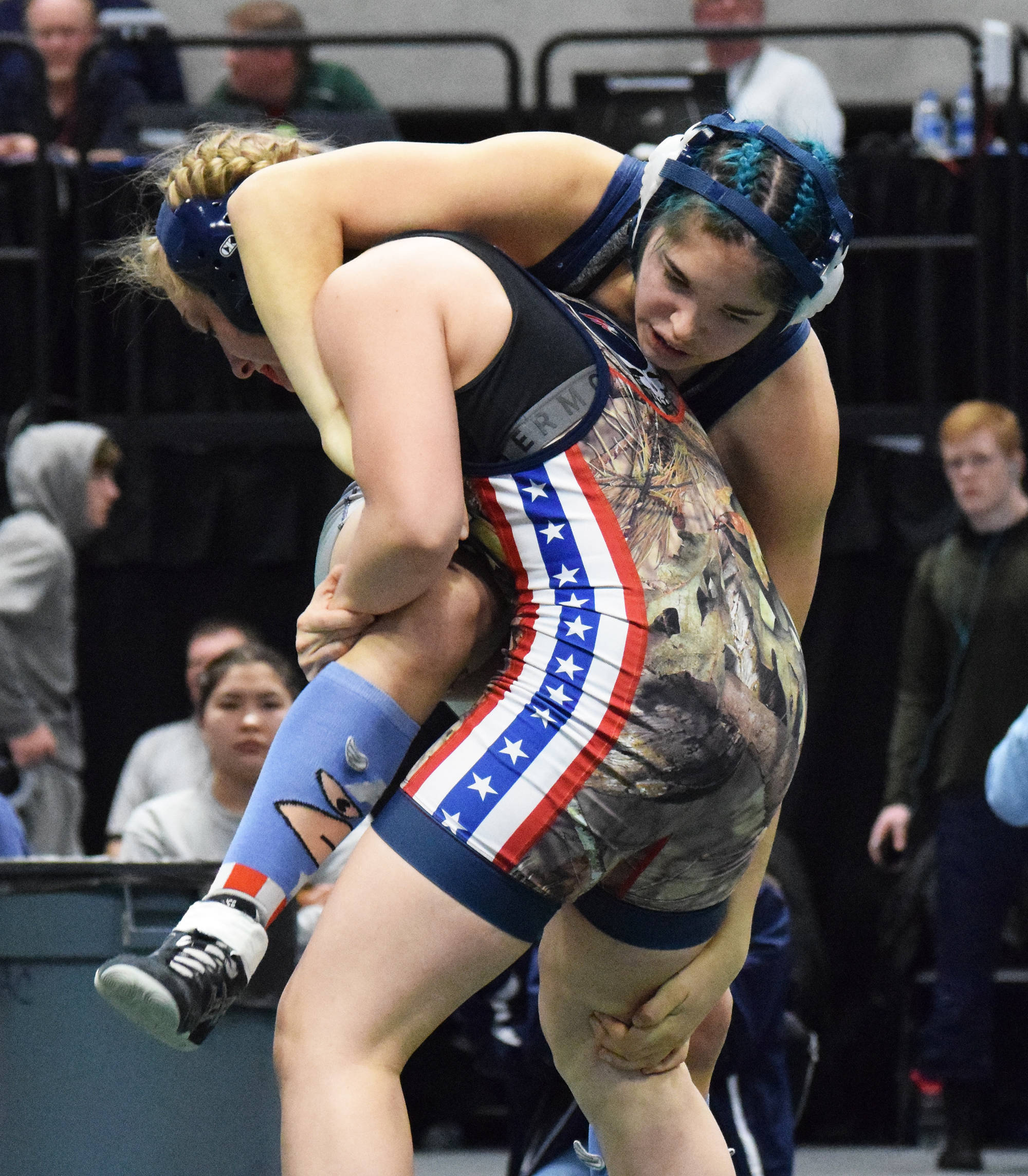 Soldotna's Trinity Donovan wrestles Emily Bellant of North Pole in the girls 145-pound final Saturday, Dec. 21, 2019, at the ASAA State Wrestling Championships at the Alaska Airlines Center in Anchorage, Alaska. (Photo by Joey Klecka/Peninsula Clarion)