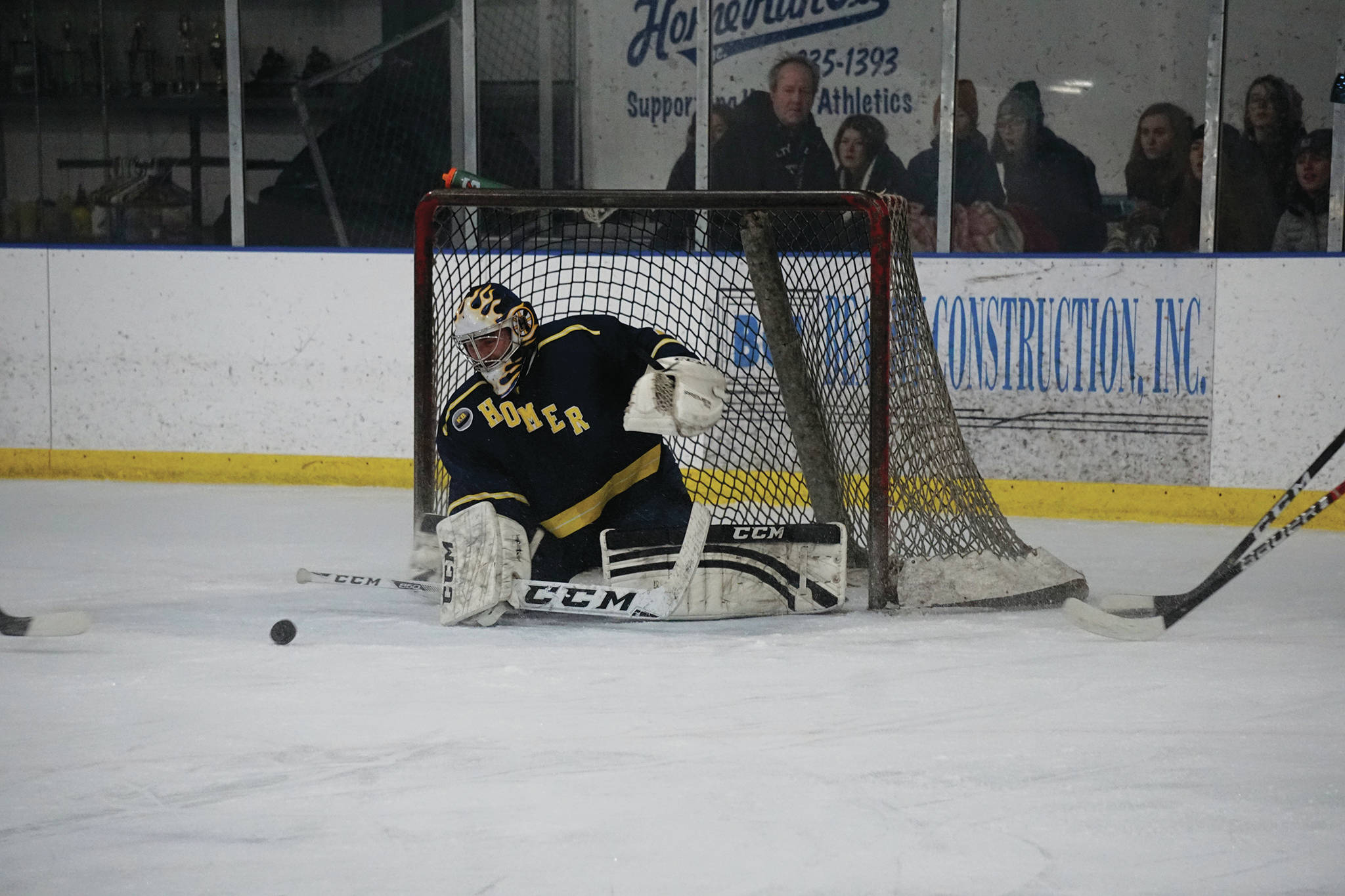 Homer High alumnus Alex Sanarov moves to block a shot during an alumni/alumnae hockey game last Friday, Dec 27, 2019, at the Kevin Bell Ice Arena in Homer, Alaska. (Photo by Michael Armstrong/Homer News)