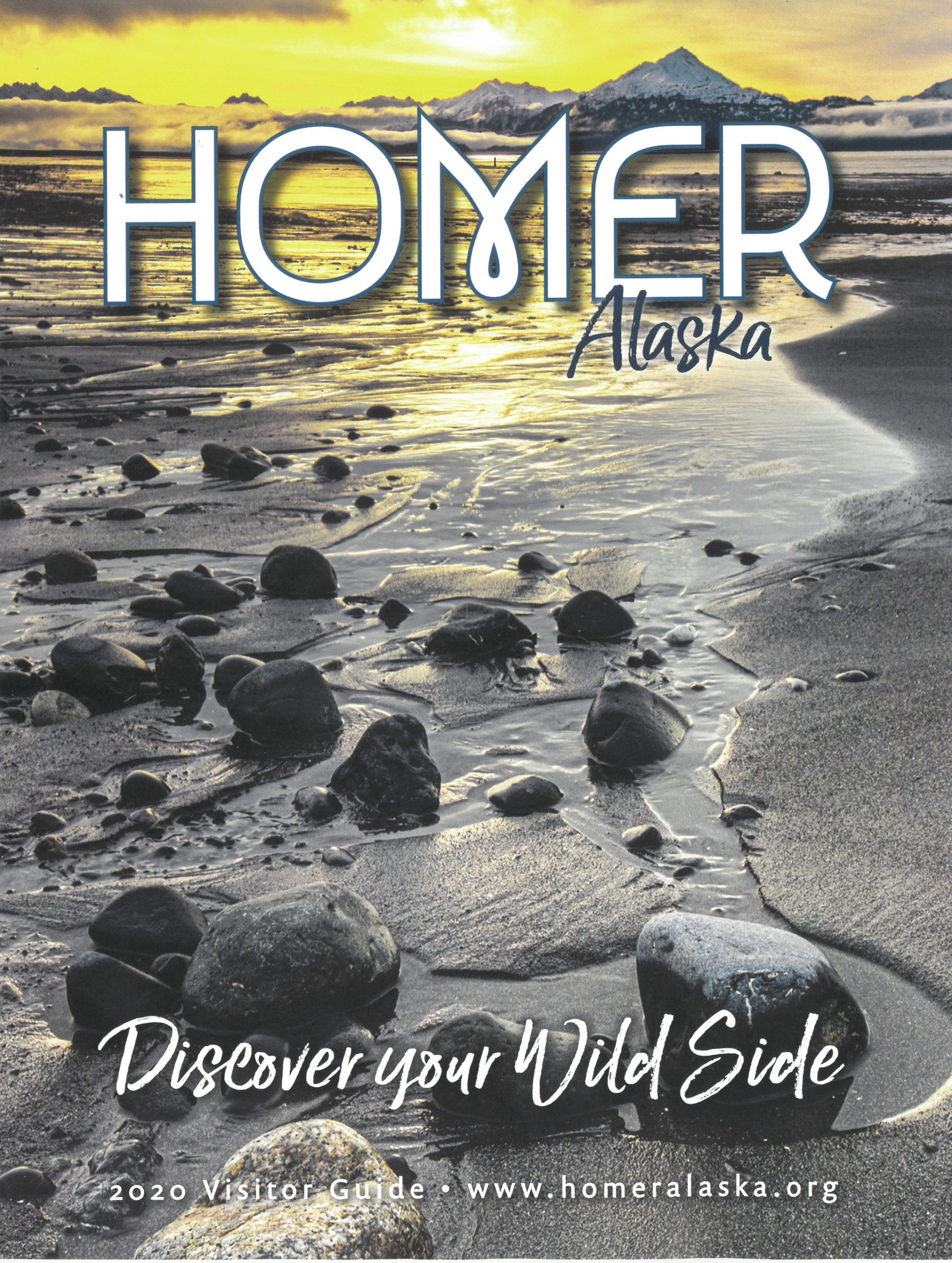 The cover of the Homer Chamber of Commerce and Visitor Center 2020 Visitor Guide was released at the chamber's annual meeting on Jan. 21, 2020, at the Alaska Islands and Ocean Visitor Center in Homer, Alaska. Edward L. Marsh took the photo on the cover. (Photo courtesy Homer Chamber of Commerce and Visitor Center)