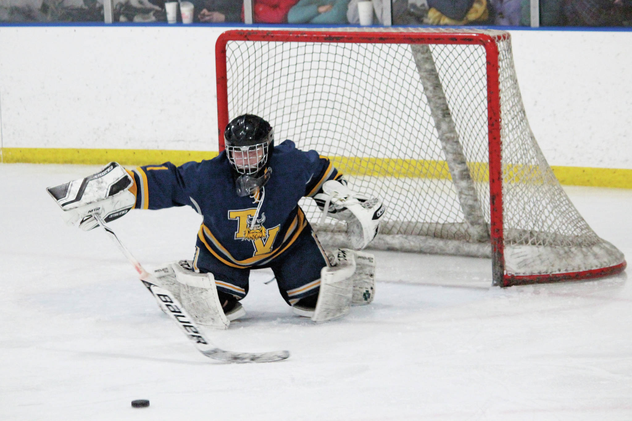 Tri-Valley School goaltender Danny Renshaw reaches out to block the puck during a Thursday, Jan. 30, 2020 hockey game against Homer High School at Kevin Bell Arena in Homer, Alaska. (Photo by Megan Pacer/Homer News)