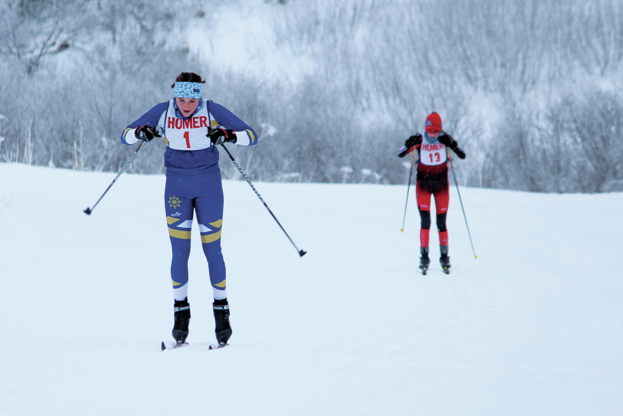 Homer's Autumn Daigle skis to the finish of a Friday, Jan. 31, 2020 classic ski race ahead of Kenai's Jayna Boonstra during the Homer Invite at the Lookout Mountain Trails on Ohlson Mountain Road near Homer, Alaska. (Photo by Megan Pacer/Homer News)