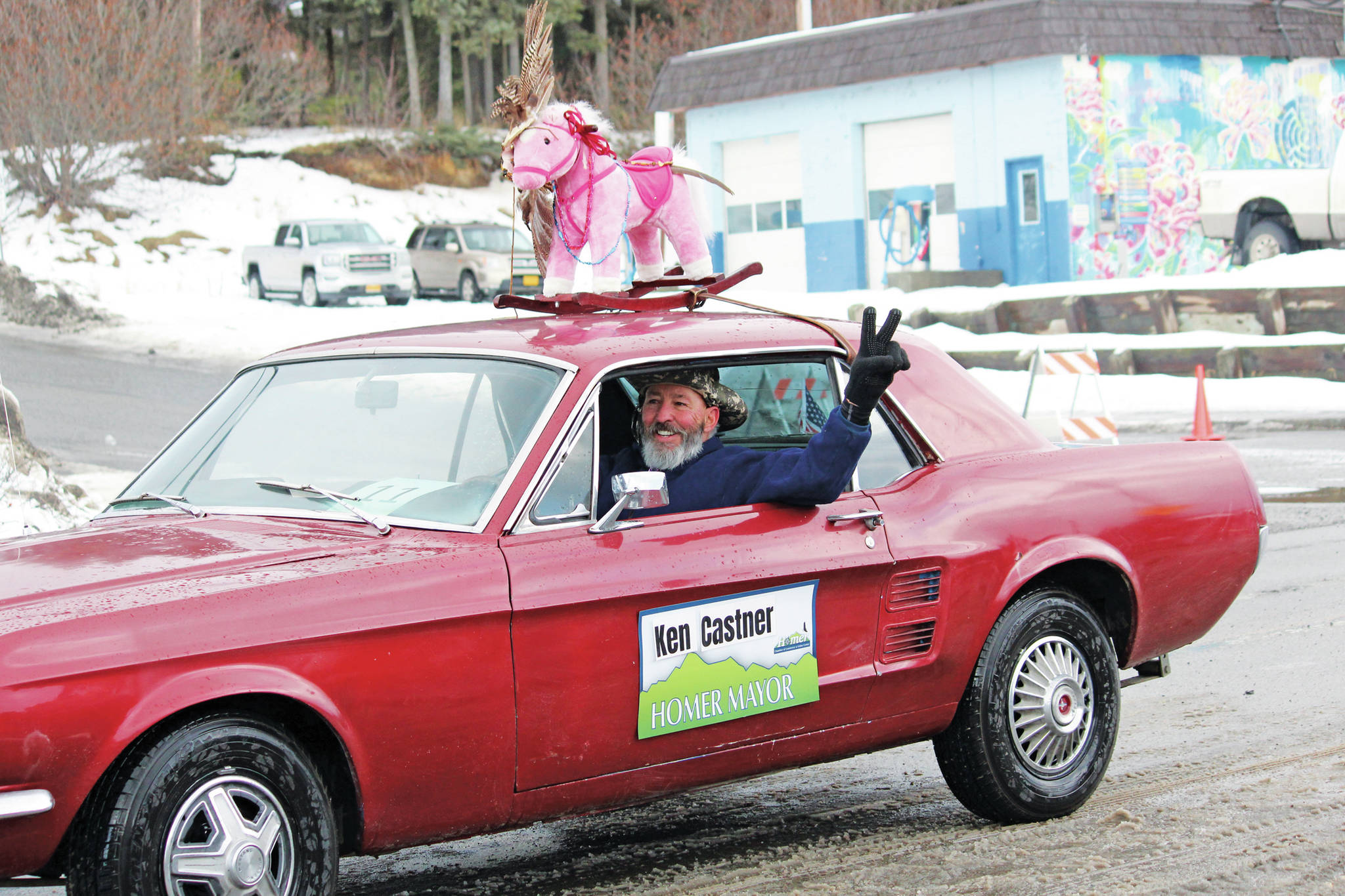 Former Mayor Bryan Zak drives the car for the float representing Mayor Ken Castner's office during this year's Homer Winter Carnival Parade on Saturday, Feb. 8, 2020 on Pioneer Avenue in Homer, Alaska. (Photo by Megan Pacer/Homer News)