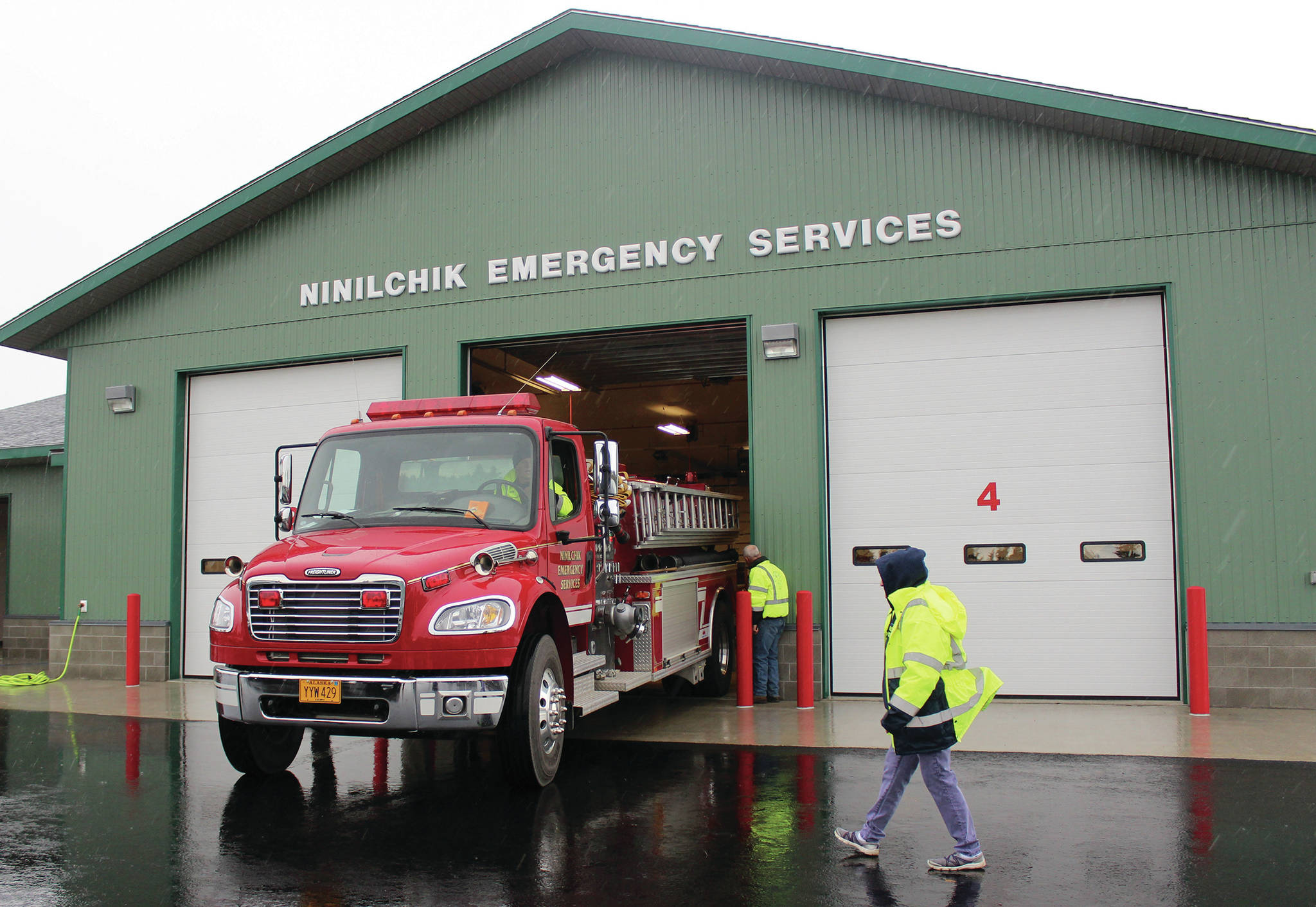 Ninilchik Fire Chief David Bear moves the fire truck out of the new Ninilchik Emergency Services building on Aug. 9, 2014, to make room for visitors to the open house of the new NES building. (Homer News file photo)