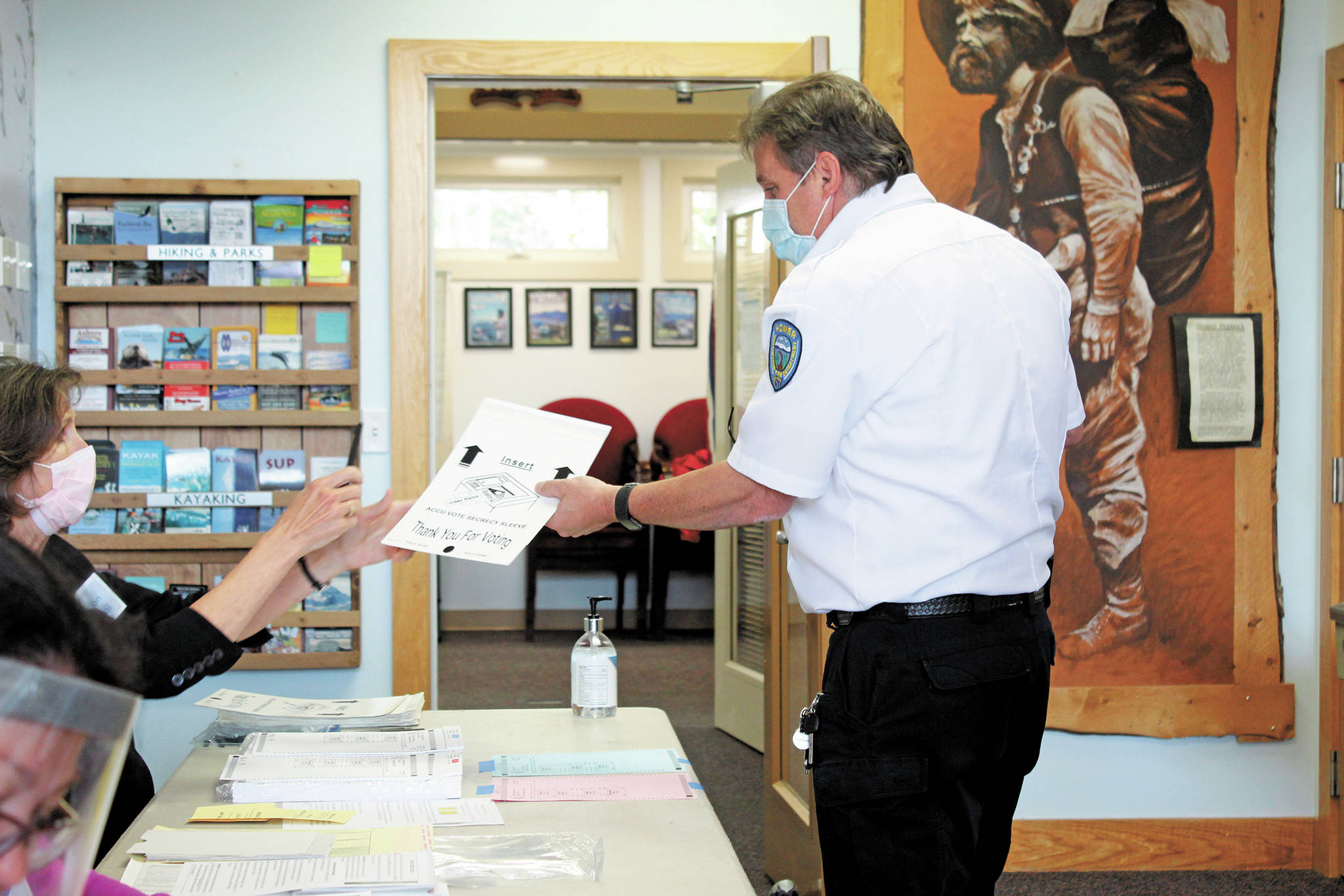 Homer Volunteer Fire Department Chief Mark Kirko collects his ballot during the Primary Election on Tuesday, Aug. 18, 2020 at the Homer Chamber of Commerce and Visitor Center polling location in Homer, Alaska. (Photo by Megan Pacer/Homer News)