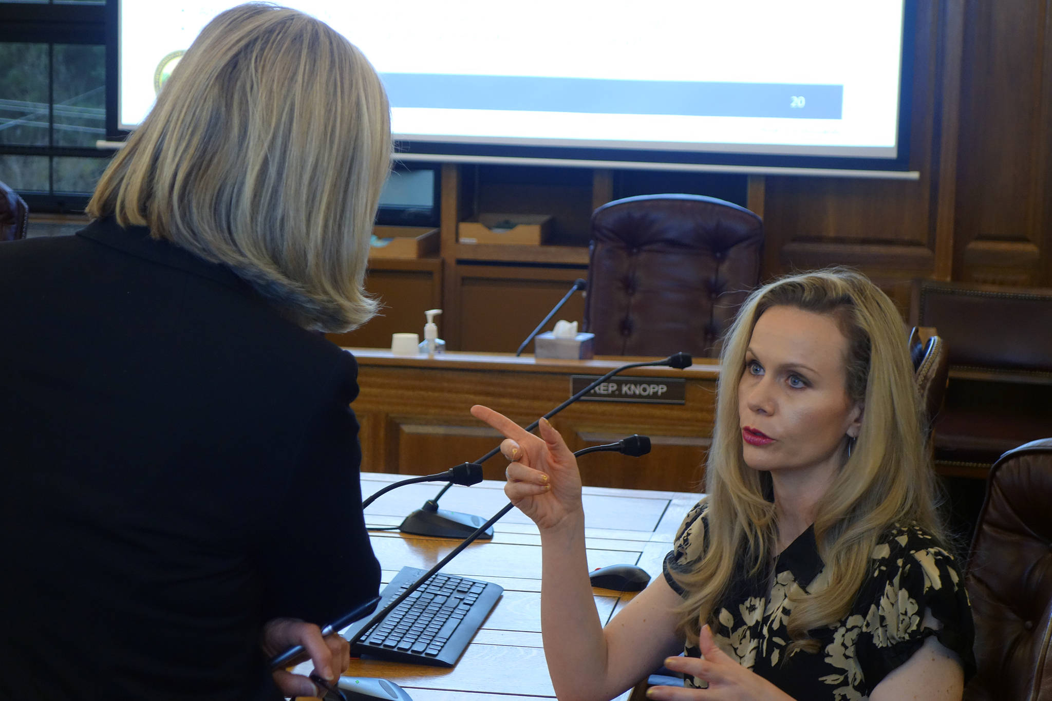 Ben Hohenstatt / Juneau Empire File                                 Rep. Andi Story, D-Juneau, talks with Department of Administration Commissioner Kelly Tshibaka following a House Administration Committee Finance Subcommittee meeting in this January 2020 photo.