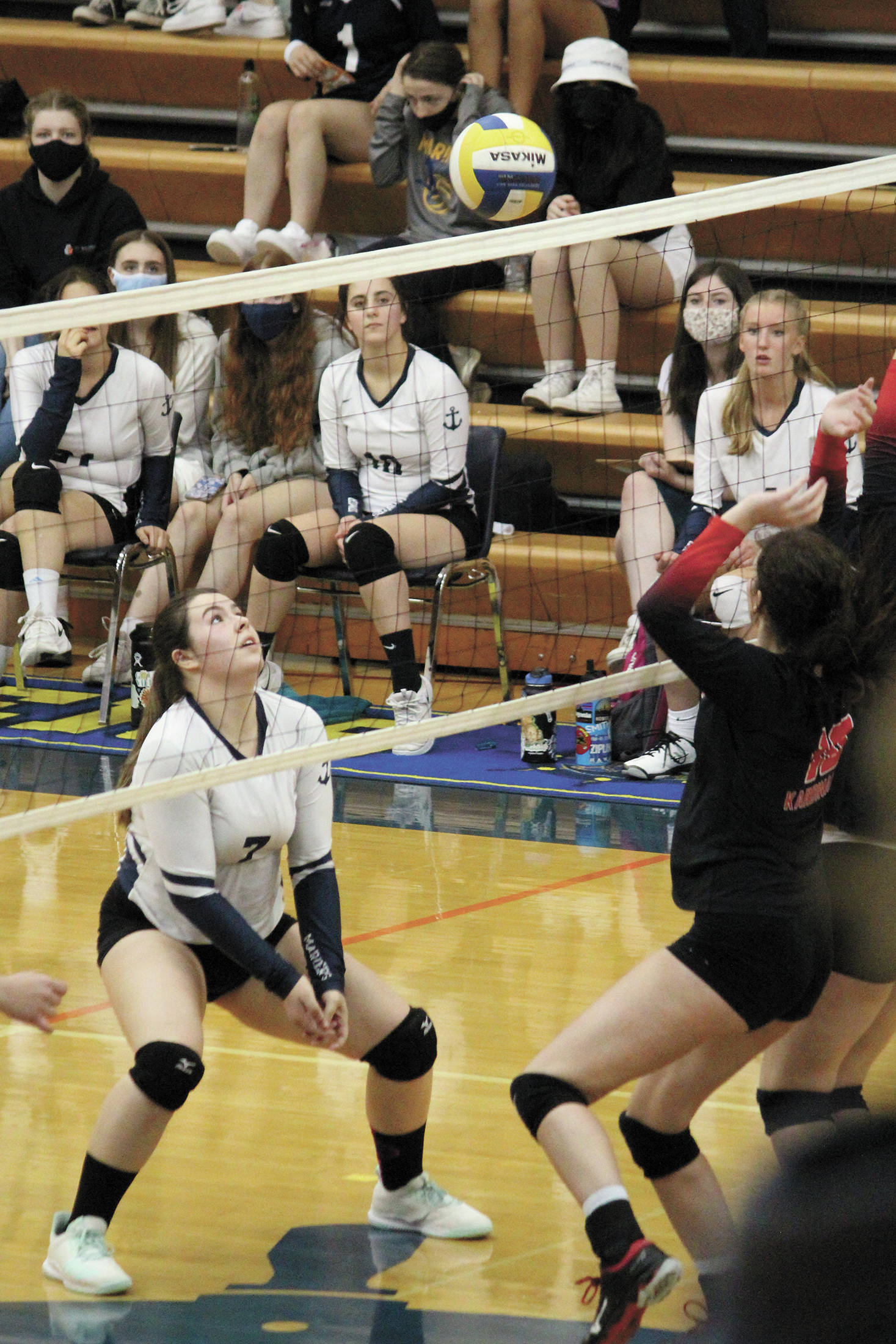 Homer's Katlyn Vogl waits for a blocked hit to come back down during a Tuesday, Oct. 6, 2020 volleyball game against Kenai Central High School in the Alice Witte Gymnasium in Homer, Alaska. (Photo by Megan Pacer/Homer News)