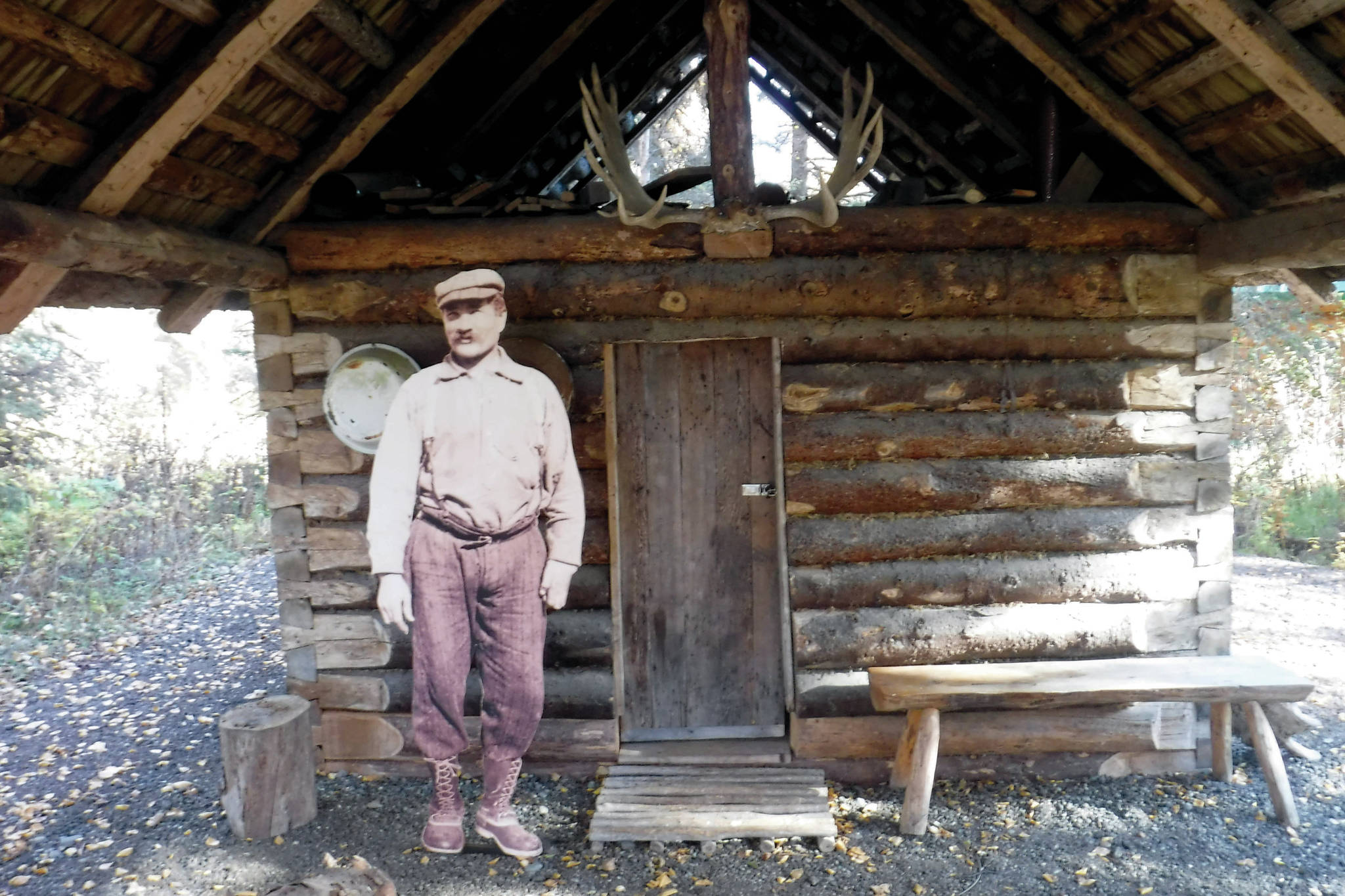 Andrew Berg outside his ҈omesteadӠcabin, which stood originally on Tustumena Lake and now stands at the headquarters of Kenai National Wildlife Refuge. (Photo provided by Kenai National Wildlife Refuge)