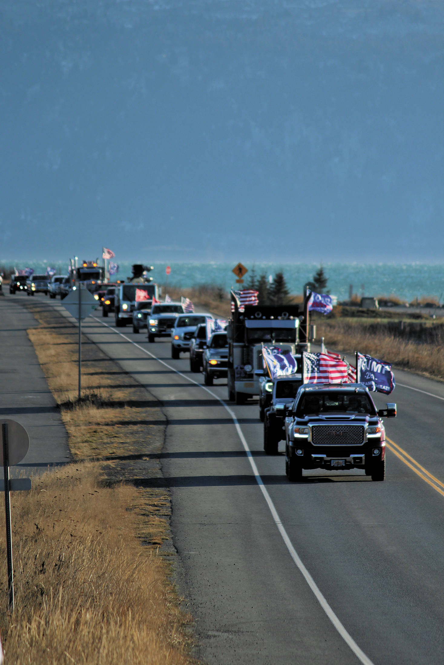 Participants in a vehicle parade to support President Donald Trump make their way off the Homer Spit on Sunday, Nov. 1, 2020 in Homer, Alaska. Organized by a Homer resident, the event was not part of similar parades that took place across the state and country over the weekend. (Photo by Megan Pacer/Homer News)
