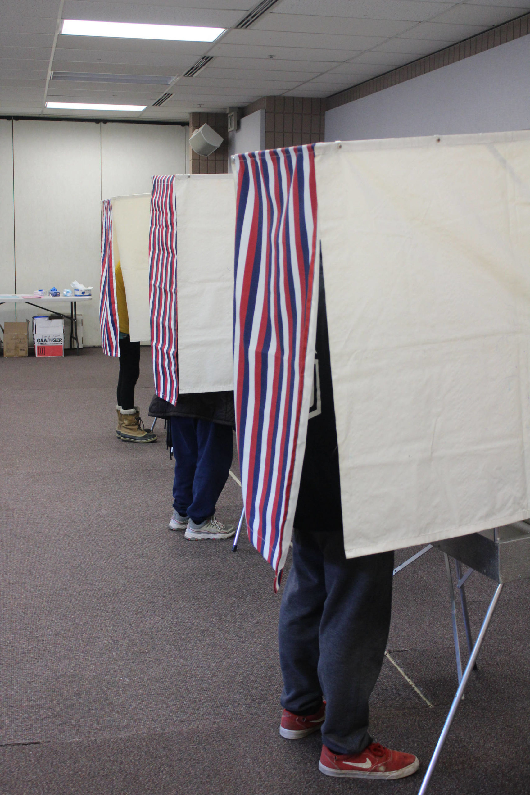 Voters fill out ballots in voting booths at the Soldotna Regional Sports Complex on Tuesday, Nov. 3 in Soldotna, Alaska. (Photo by Ashlyn O'Hara/Peninsula Clarion)