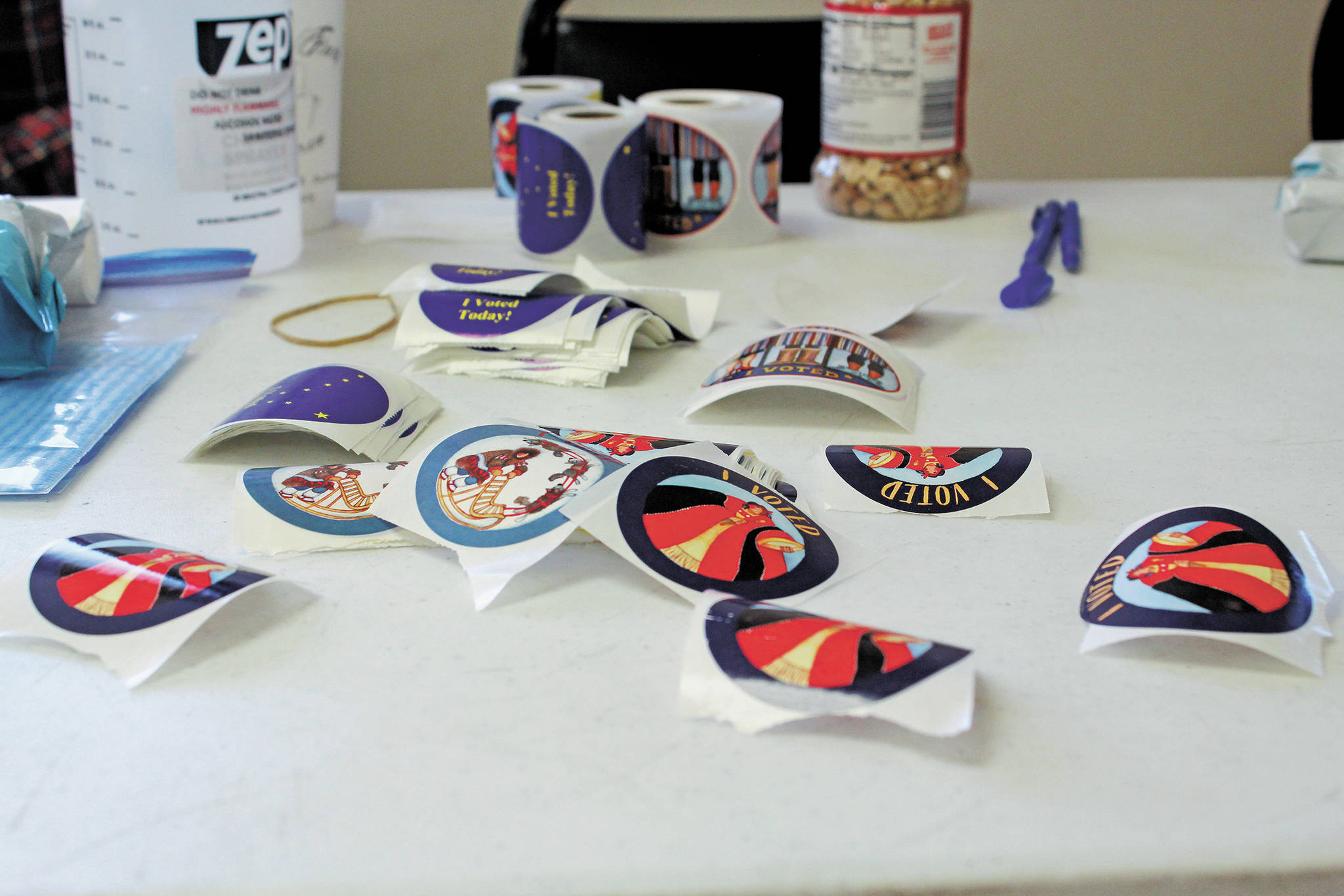 """I Voted"" stickers wait on a table in the Kachemak Community Center for voters to pick them up Tuesday, Nov. 3, 2020 in Kachemak City, Alaska. (Photo by Megan Pacer/Homer News)"